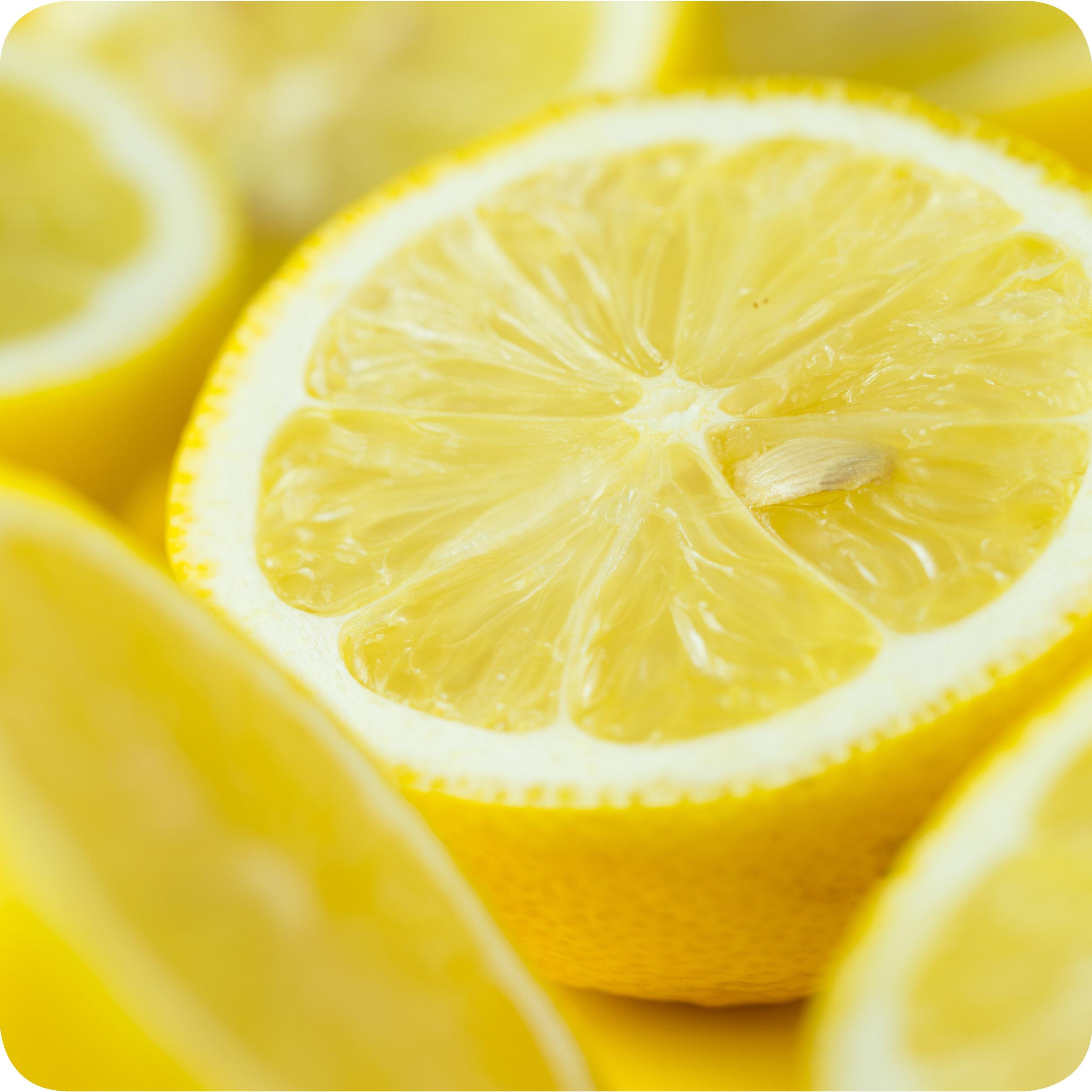 A sliced lemon, surrounded by more sliced lemons.