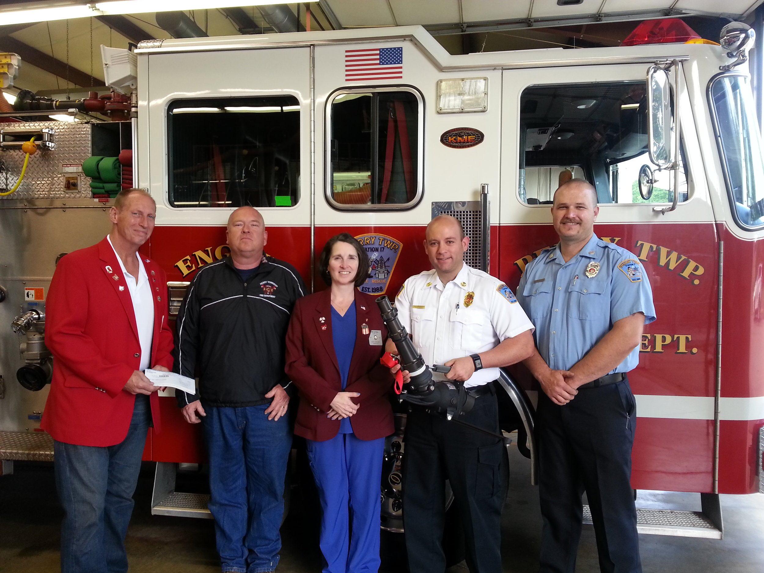 Pictured presenting the check is Wayne Gorby, Exalted Ruler to Perry Township Volunteer Fire Department's Chief Bruce Whitaker; Kim Chapman,  CSG Chairman; Asst. Chief Brandon Smith who's holding the Quick Attach Monitor and Fireman Brandon Planisky.