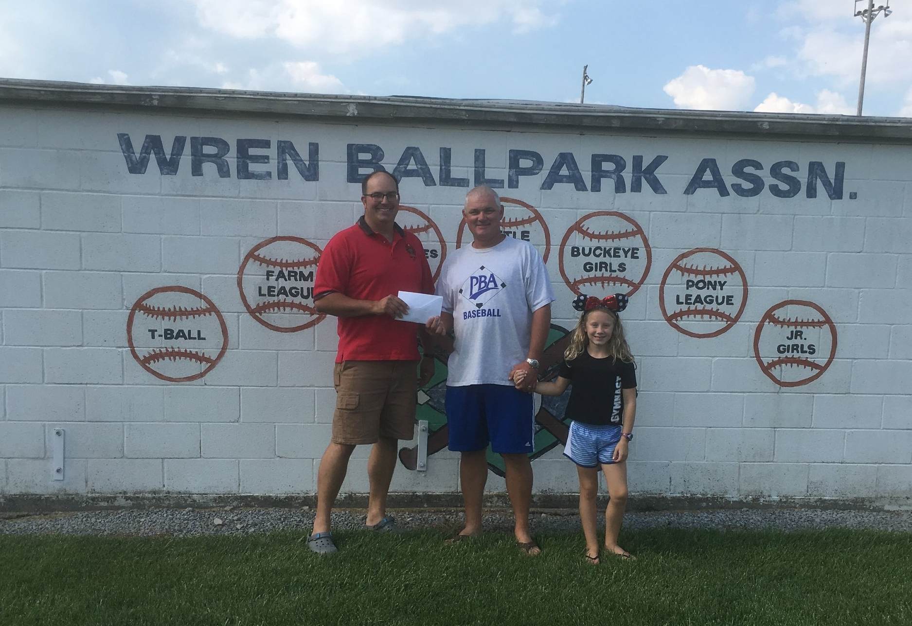 Shown are, left to right, Shane Mills representing the Golf Committee presenting the check to Jeremy Kitson of the Wren Ball Park Association.