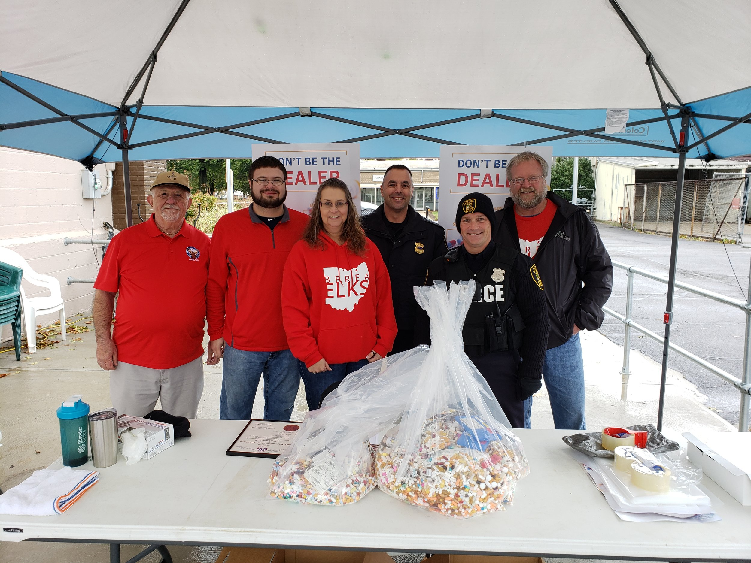 Pictured, from left:  Members Bob Bickford, Jeff Coyle (ER), Danielle Mahany (secretary), Officers Pat Greenhill and Chuck Gute of Berea Police, and member John Masterson.