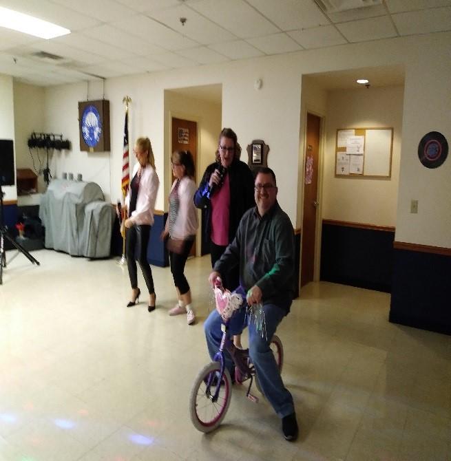 "Winners of the dance contest, Lisa Mischovich, Tami Cox, Amanda Skinner & the ""Leader of the Pack"", Chris Skinner."