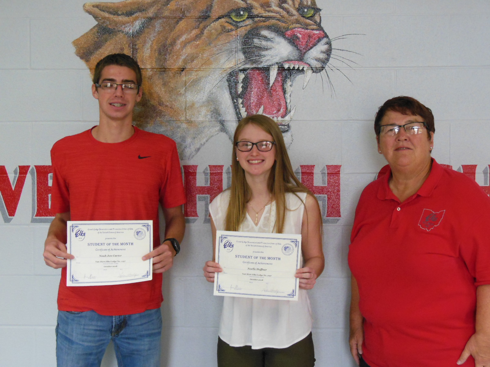 Pictured left to right are: Noah Carter and Noelle Heffner with Linda J. Stanley, Student of the Month Chairperson.
