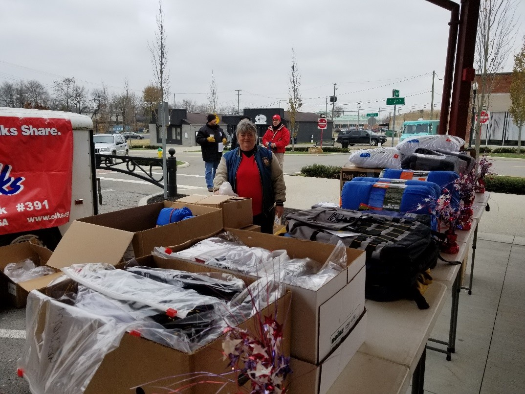 Pictured is ENF Chairman Kathy Wise with the items passed out at the Stand Down to needy and homeless veterans.