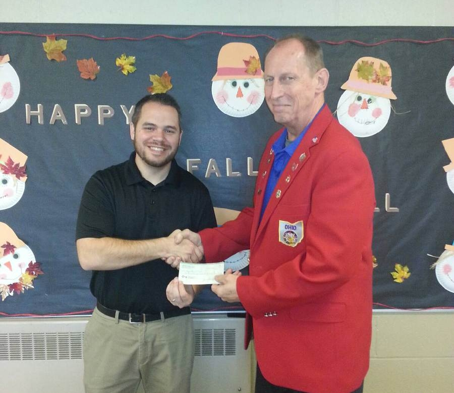 On the left is Principal Andrew Garber accepting the check from Wayne Gorby, Exalted Ruler.
