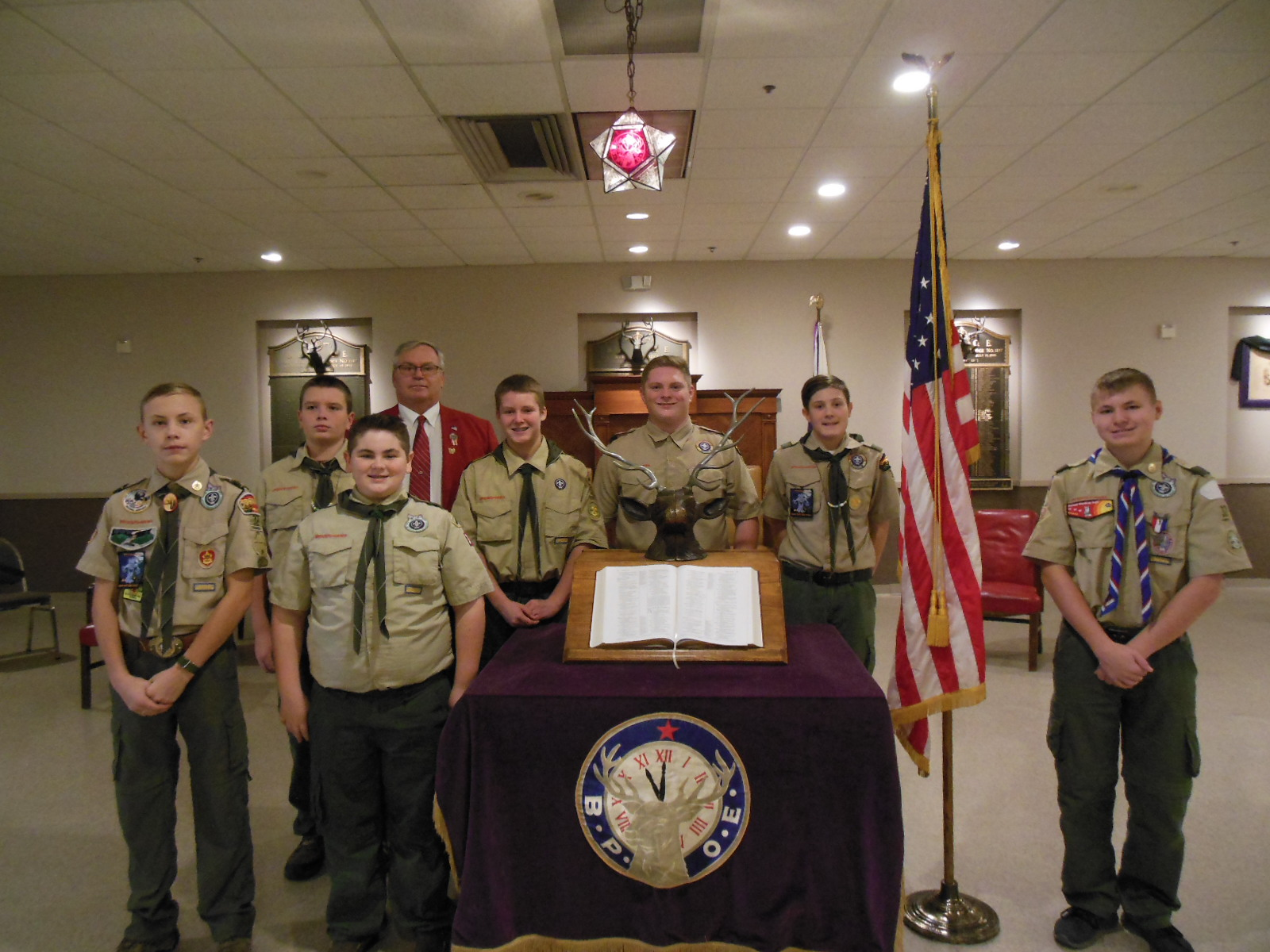 Pictured are Keith Collins, Lodge Veteran Committee Chairman along with members of Boy Scout Troop 32.