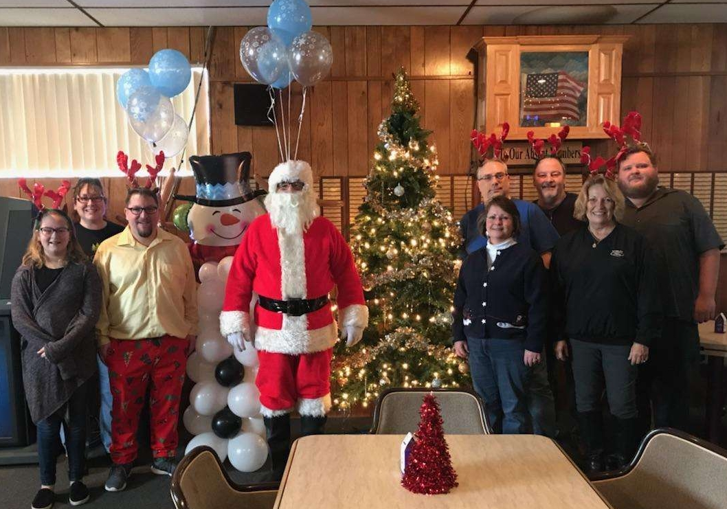 Photo Santa with his helpers: left to right. Shay and Emma Oxenrider, Shawn Bartly, Santa, Scott and Judy Peters, Tom Masburger, Michele Larue and Mike Fallon.