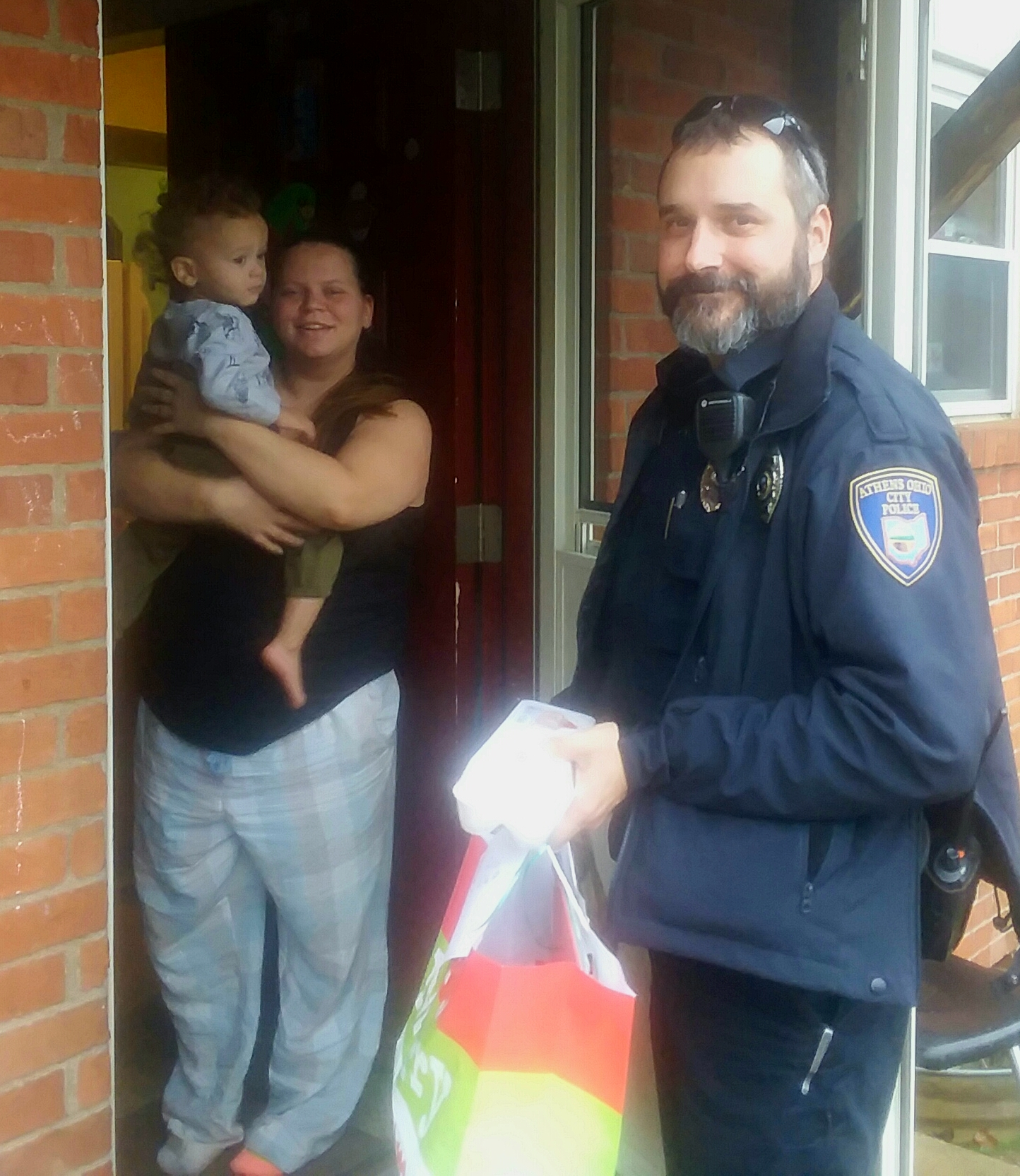 Pictured is Athens Police Officer Destry Flick, who helped the Athens Elks Lodge #973 deliver the items to families within the city of Athens.