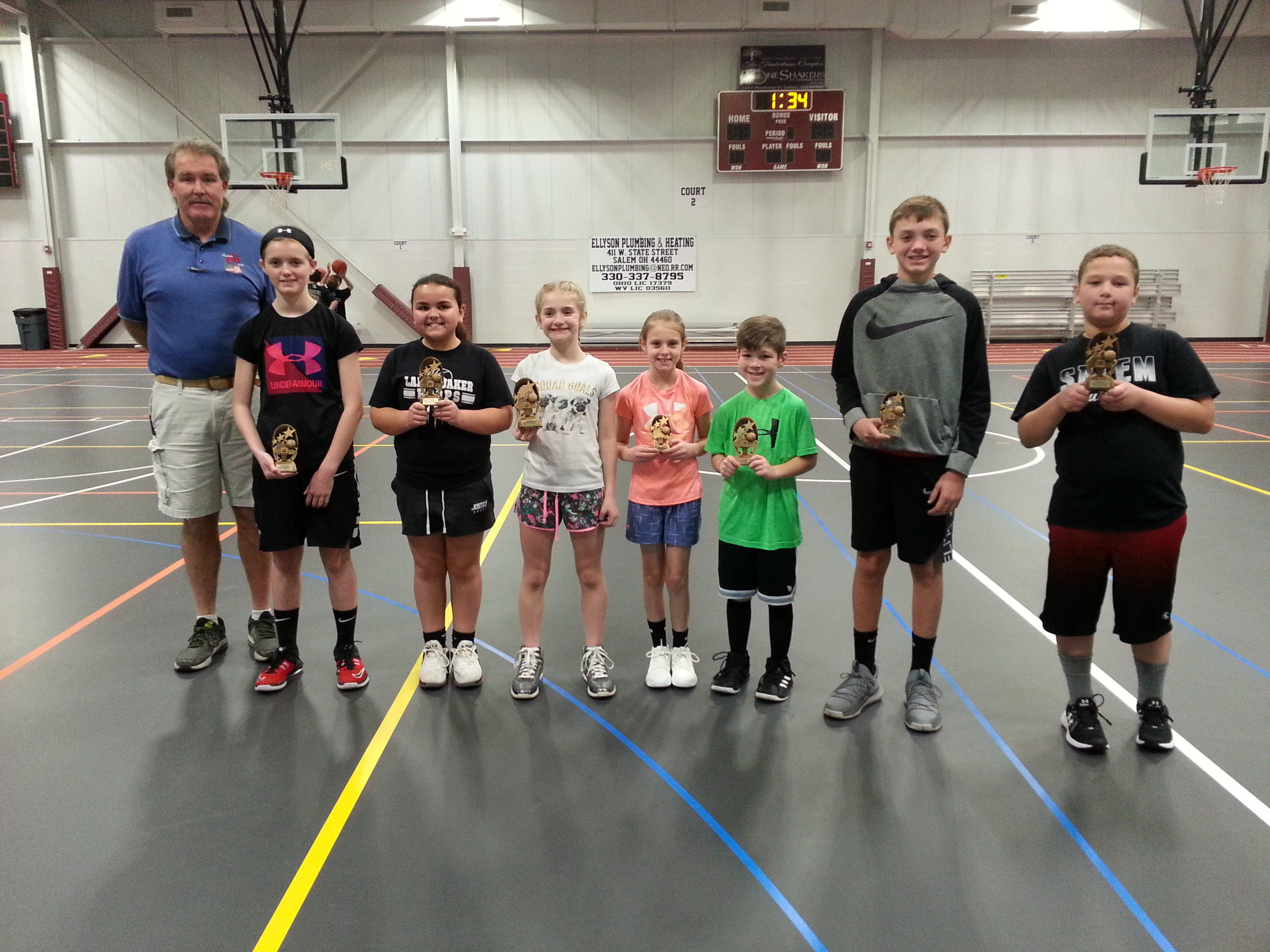 Those pictured left to right are Douglas Rudibaugh, PER and Chairman; Alaina Johnston 1st in girls 12-13, Macey Troy 1st in girls 10-11, Destany Cunningham runner-up and Alivia Ruth 1st in girls 8-9; Blake Bezon 1st in 8-9 boys; Luke Courtney runner-up and Steven Landfried 1st in the boys 12-13. The winners will continue onto the NE District Hoop Shoot contest on Saturday, January 16th at the Ravenna High School.