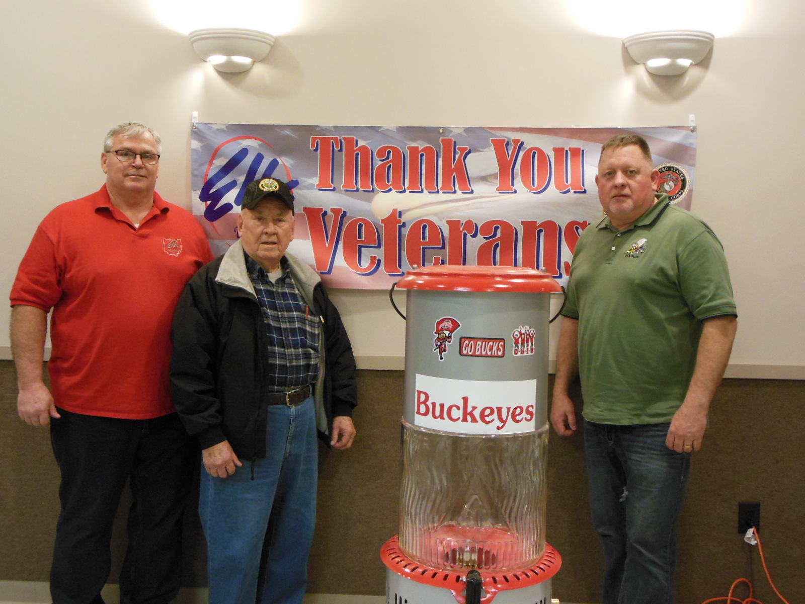Pictured are, left to right: Keith Collins, Marine Veteran and Elks Lodge Veteran Committee Chairman; Carl Beck, US Army Veteran and lodge member who donated the lamp and Raymond Haas, US Navy Veteran and lodge member who was the winner of the lamp.