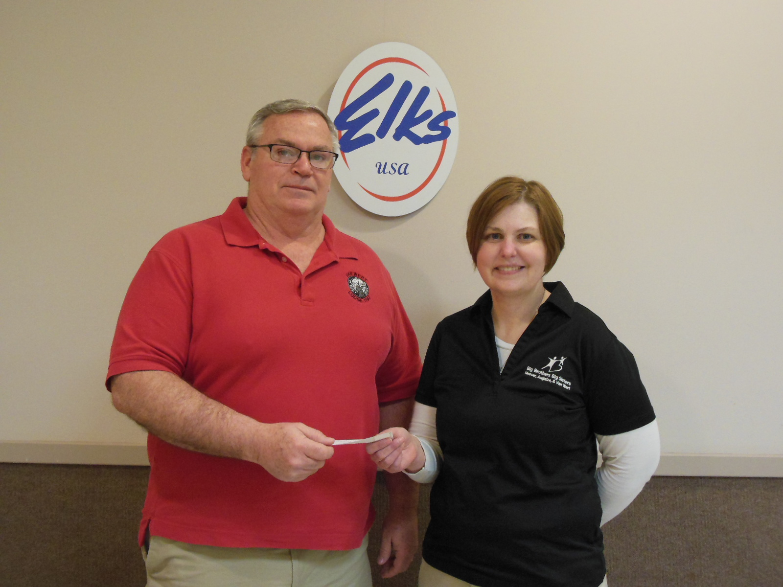 Pictured are, left to right, Keith A. Collins, Leading Knight presenting the check to Nancy Eberle of MAV Youth Mentoring Program.