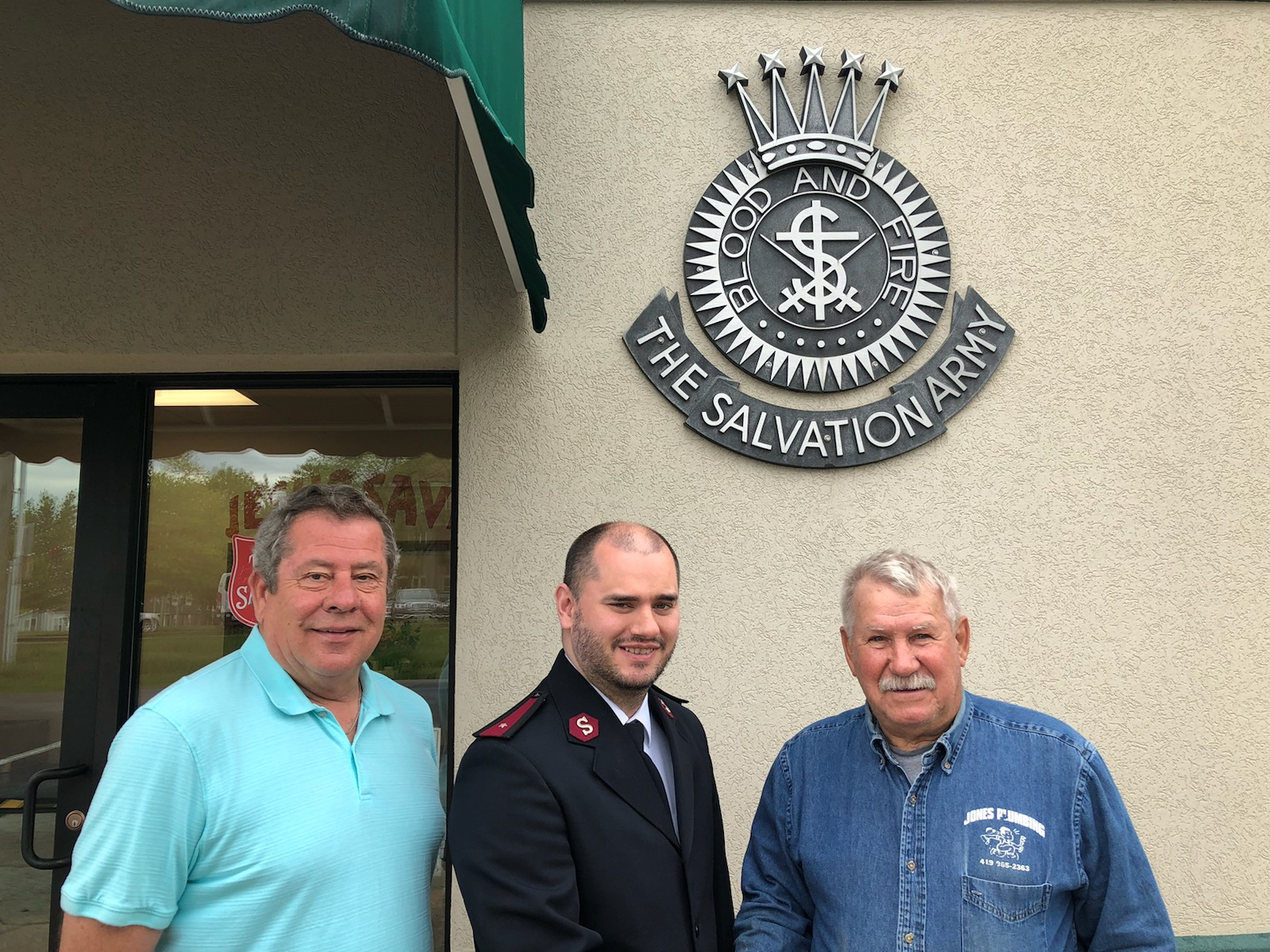 Pictured, left to right are: Jim Sowers, golf committee member; Joshua Bookman representing the Salvation Army and John Jones, golf committee member.