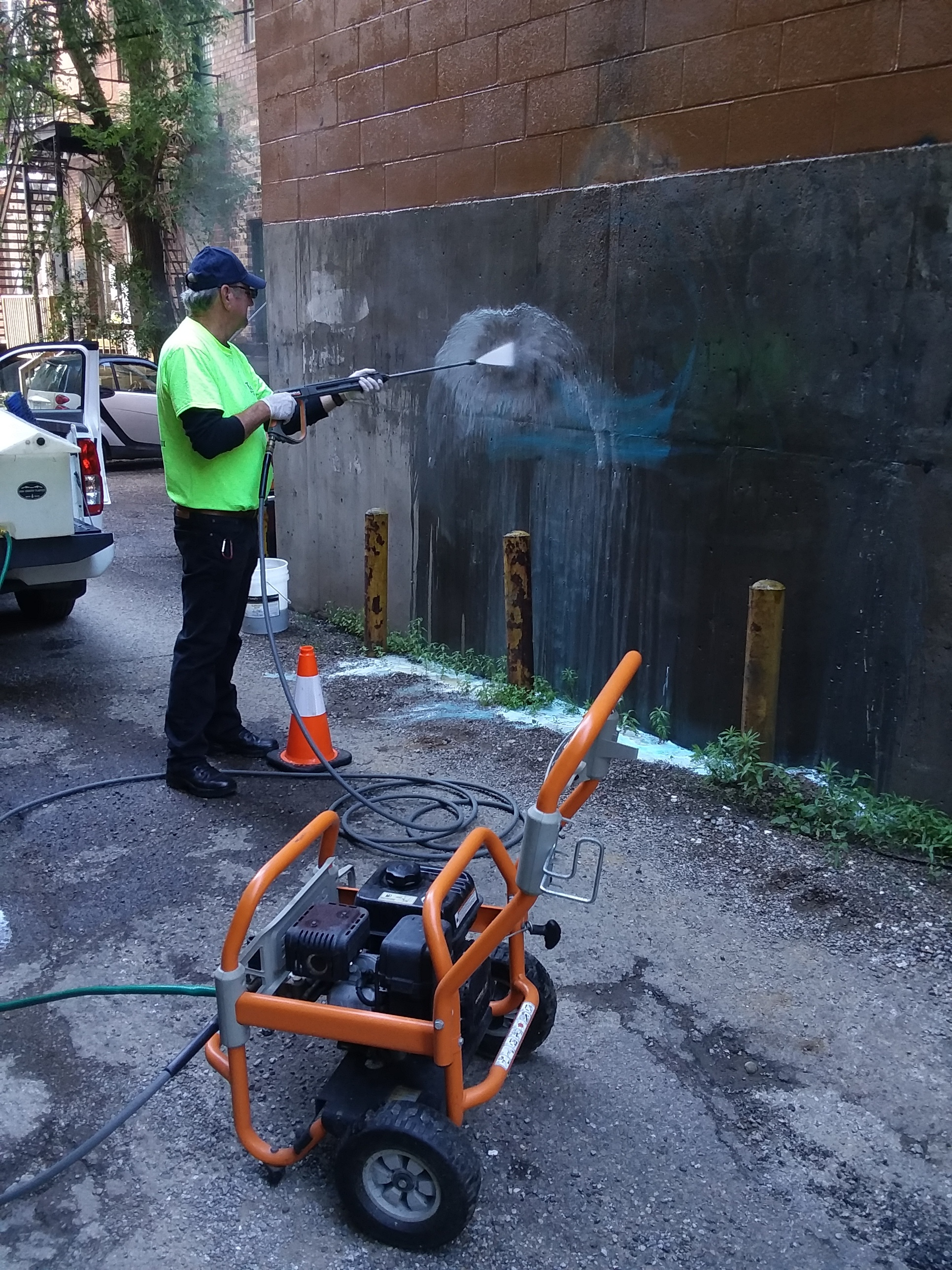 Pictured: Elks member Dave Williams using the power washer to remove the graffiti