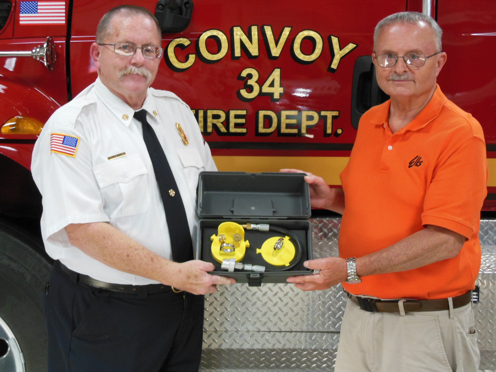 Pictured, left to right are Fire Chief Gary Kresischer and Michael C. Stanley, Lodge Elks National Foundation Chairman.