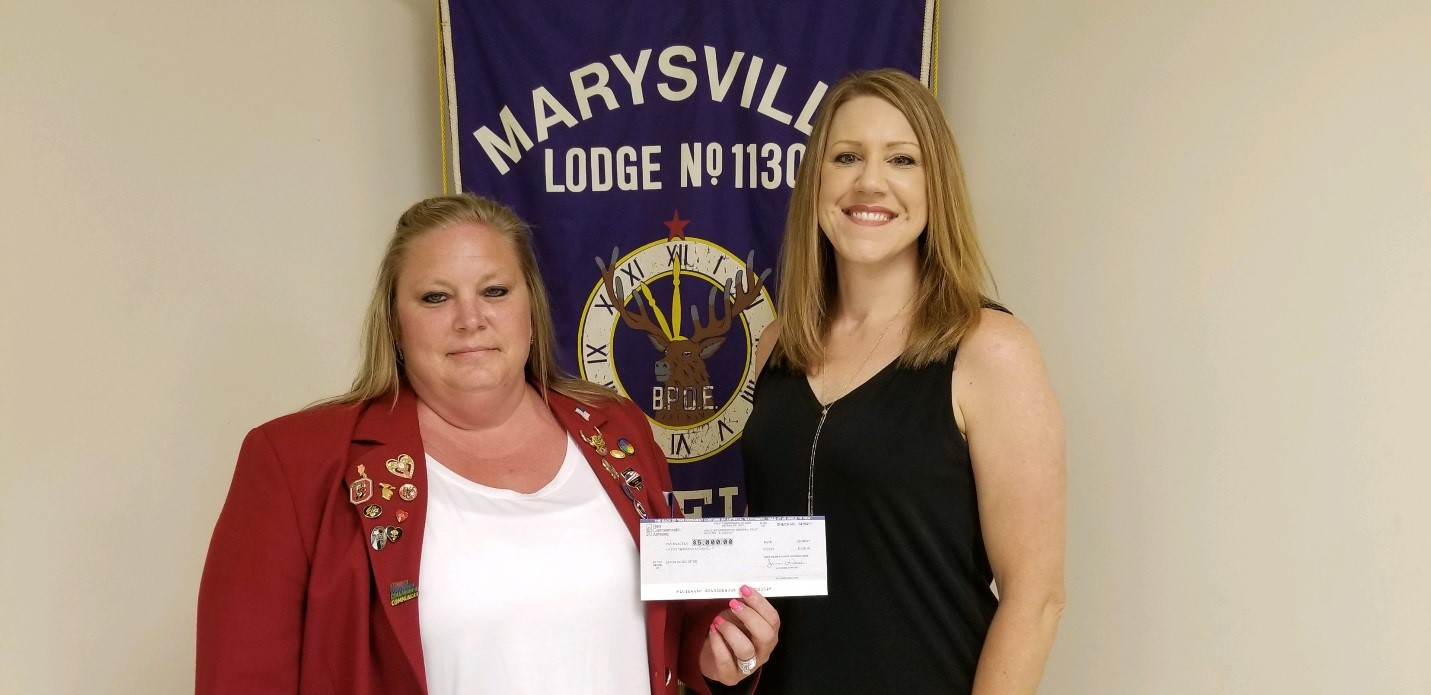 Pictured above is Exalted Ruler Billie Jo Humble and Sarah Seeberg, Director of Support Services, with the UCBDD.