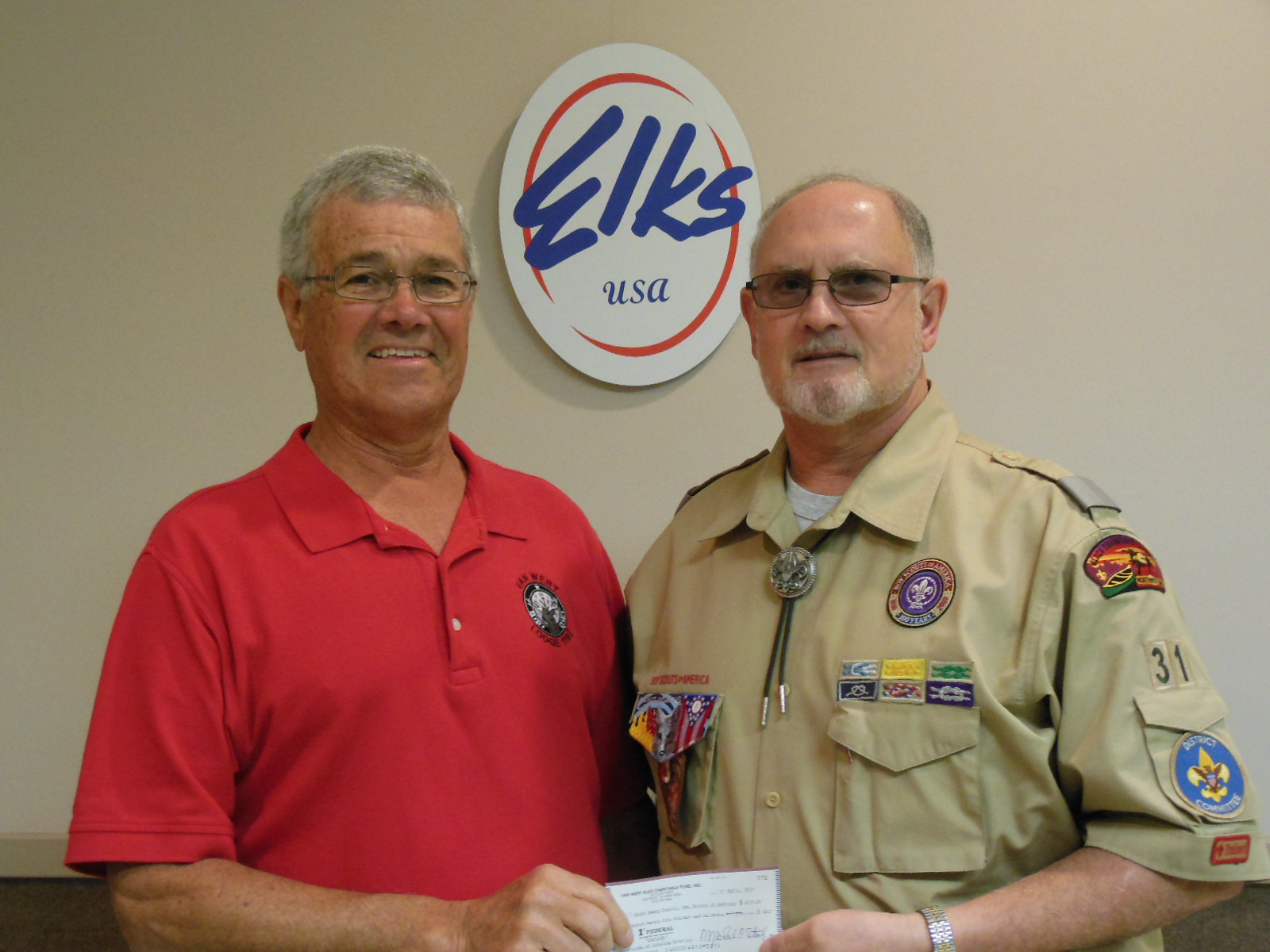 Pictured are: Greg Amstutz from the Black Swamp Council accepting the check from Lodge Chaplain Larry Miller.