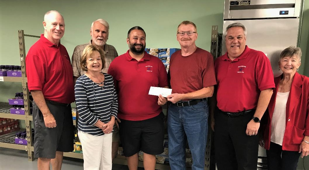 Fremont Elks Exalted Ruler Mike Sanchez, center left, presents a check for $2,000 to Jim Faist, treasurer of the Sandusky County Food Pantry. Others in the picture are, from left, Elks Trustee Mike Kelly, Roy and Marty Wilhelm of the food pantry, and Elks trustees Rick Frank and Billie Lee.