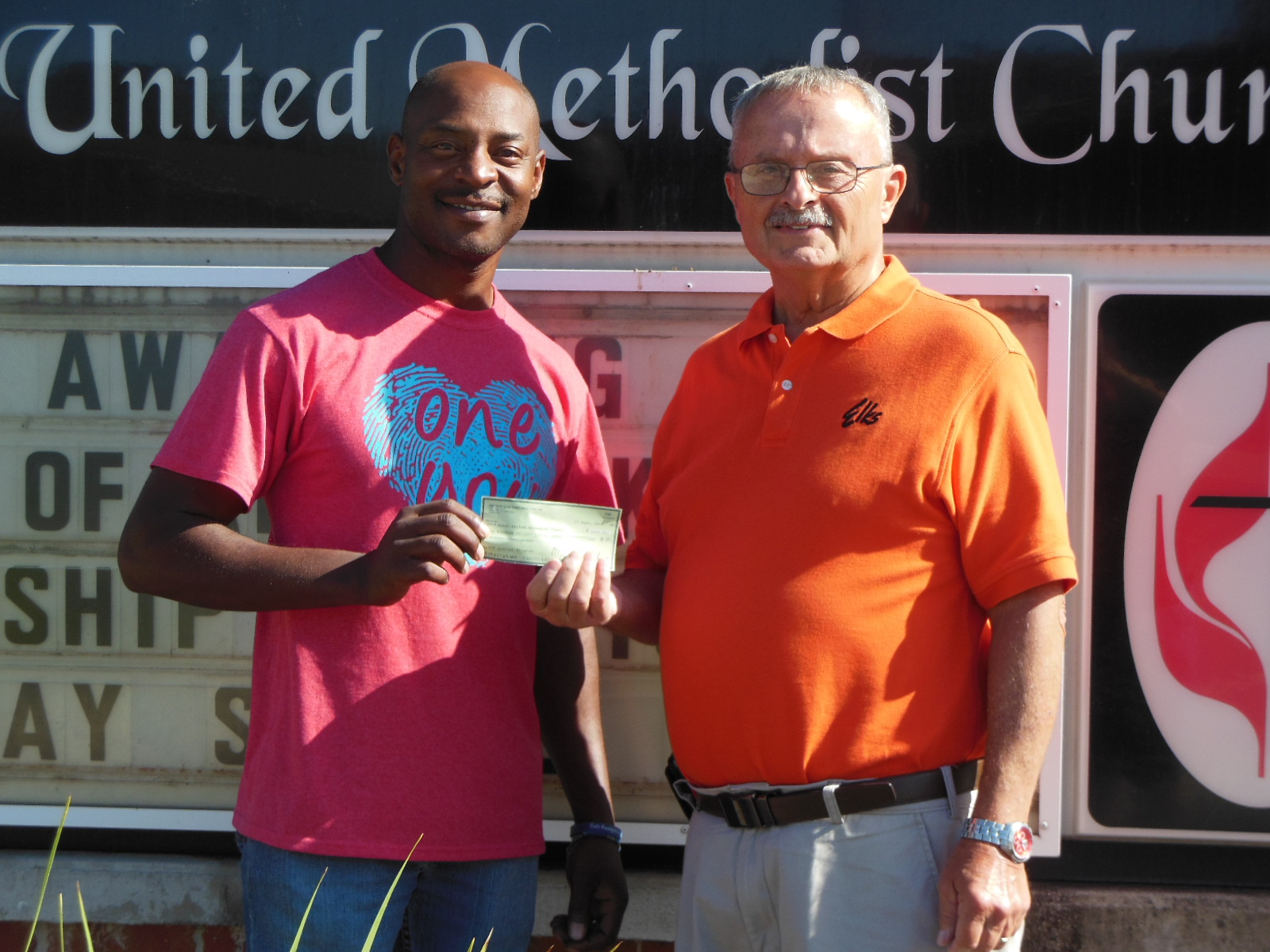 Pictured from left Demond Johnson, 5th Quarter and Mike Stanley, Lodge Elks National Foundation Chairman.