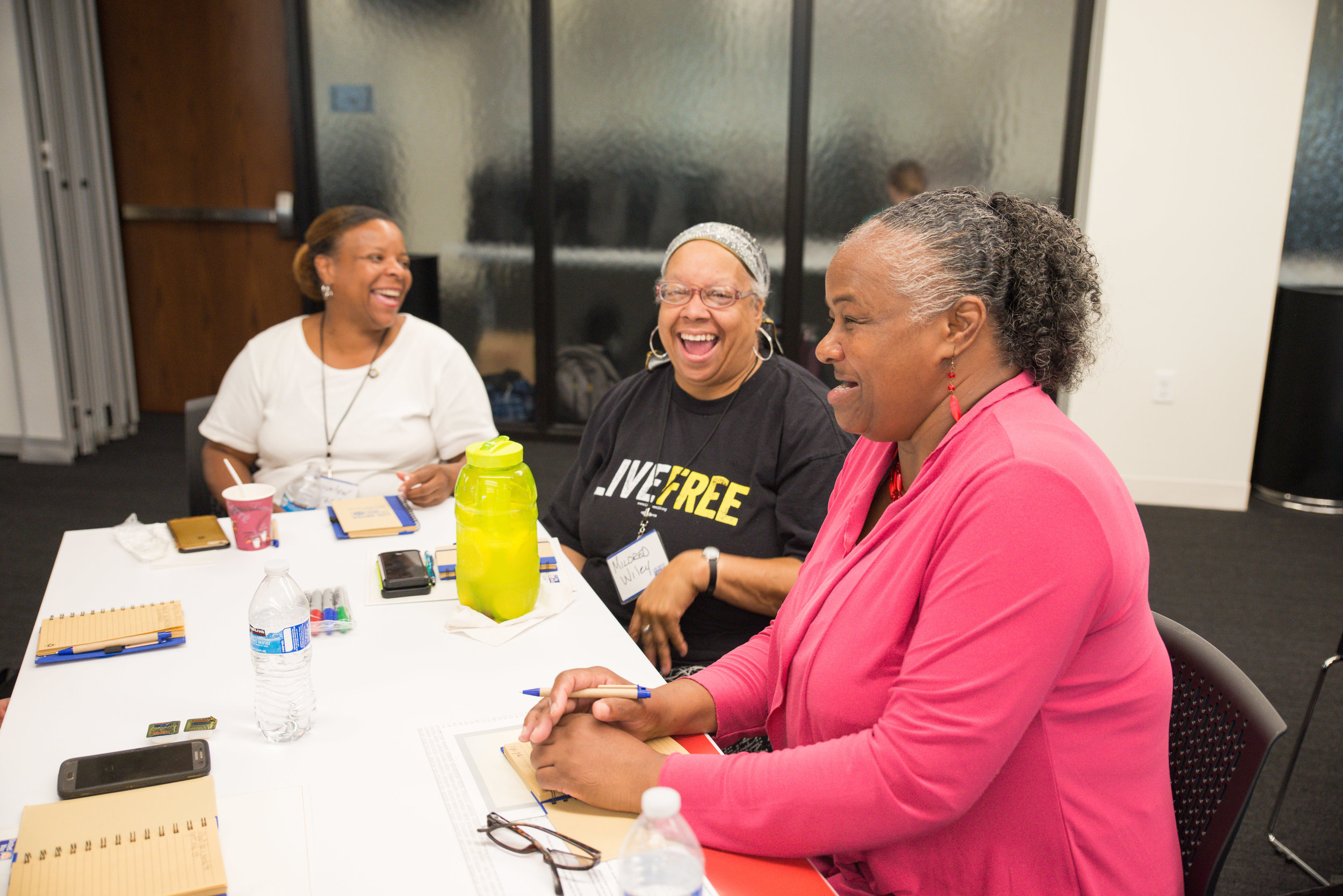 3 women share a laugh during group activity