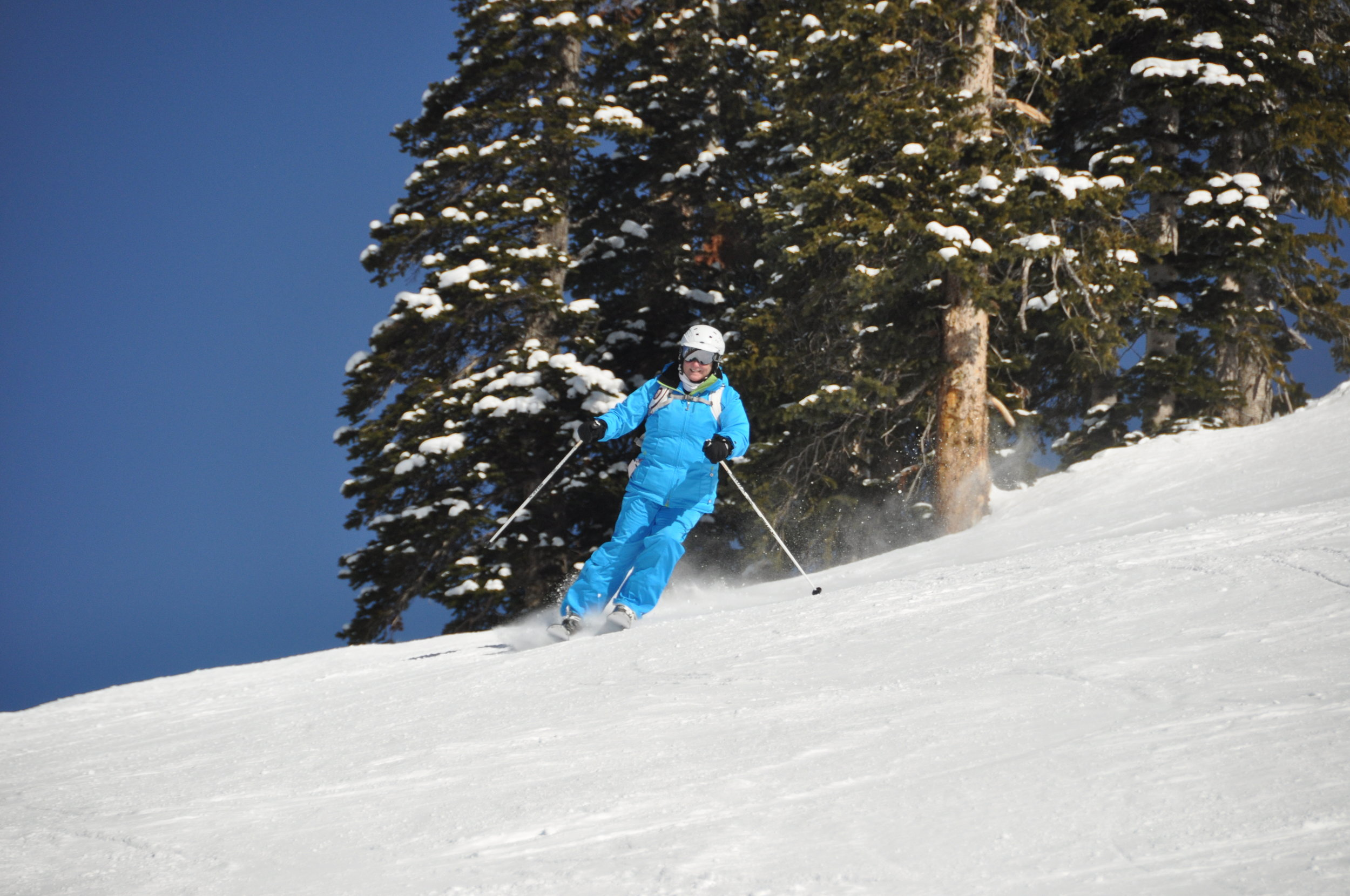 Jennifer is happy skiing perfect groomers and fresh powder on corduroy all day long