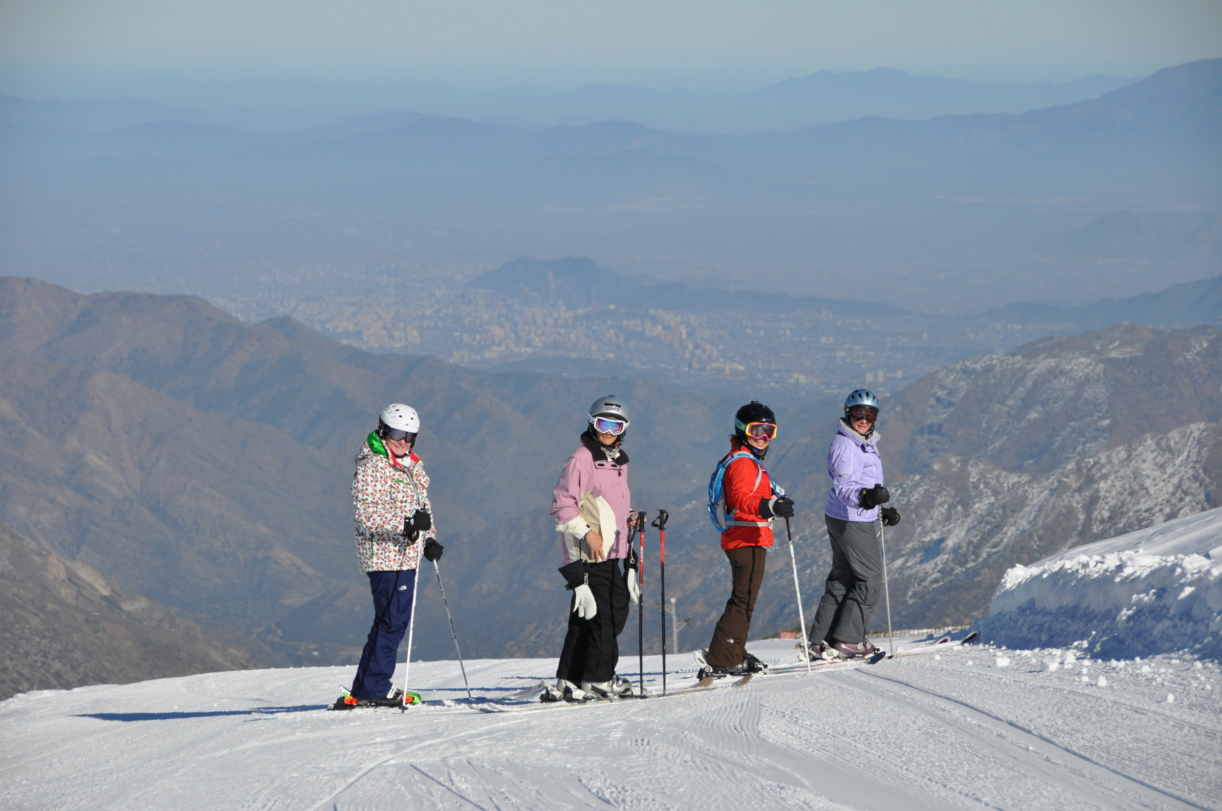 Janet and crew skiing Valle Nevado with Santiago in the background