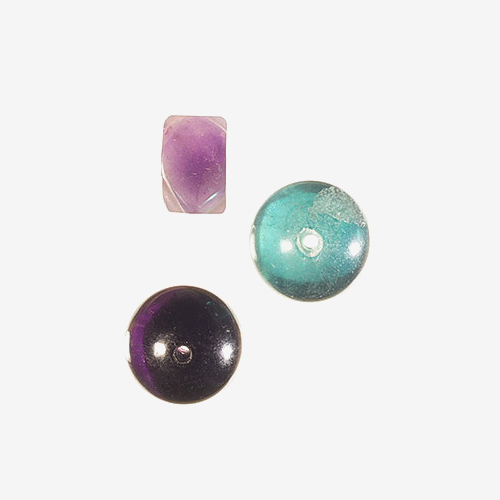 "Fluorite   Material: Natural Stone   Fluorite is a calcium fluoride mineral crystal that is found in a wide range of colors, (in visible and ultra-violet light) including pinks, light and deep greens, and purple.  Fluorite comes from the Latin word ""fluo,"" meaning ""to flow."""