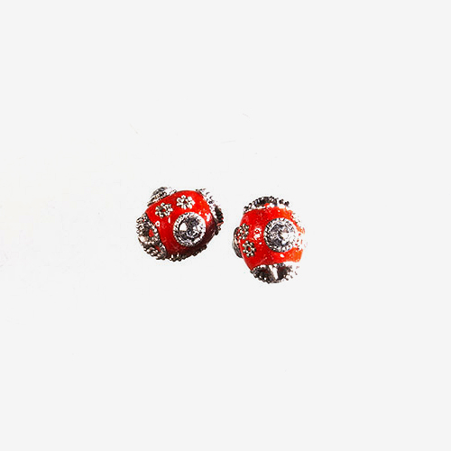 Indonesian Clay, Metal & Rhinestone   Material: Clay, Metal & Rhinestone   Handmade clay beads from Indonesia, this bead features intricate metal and rhinestone designs on its surface.