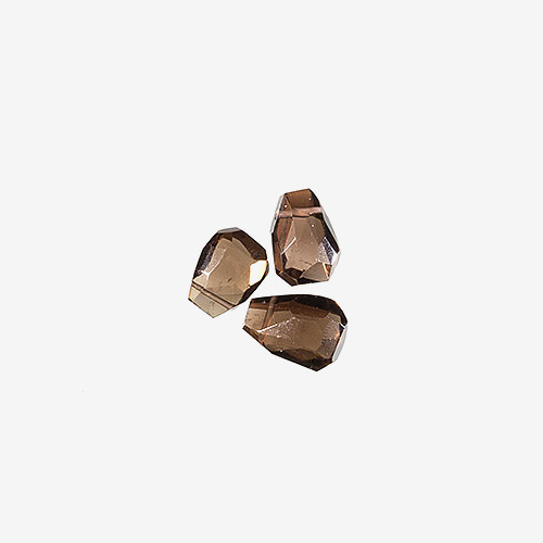 Smoky Quartz   Material: Mineral   Smoky quartz ranges in color from grey to brown. Smoky quartz is said to symbolize cooperation and has a calming effect.