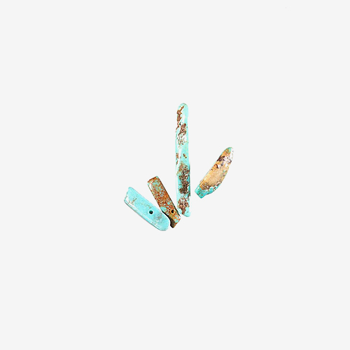 Turquoise Chips   Material: Semiprecious Stone   Linear and irregular shaped turquoise beads.