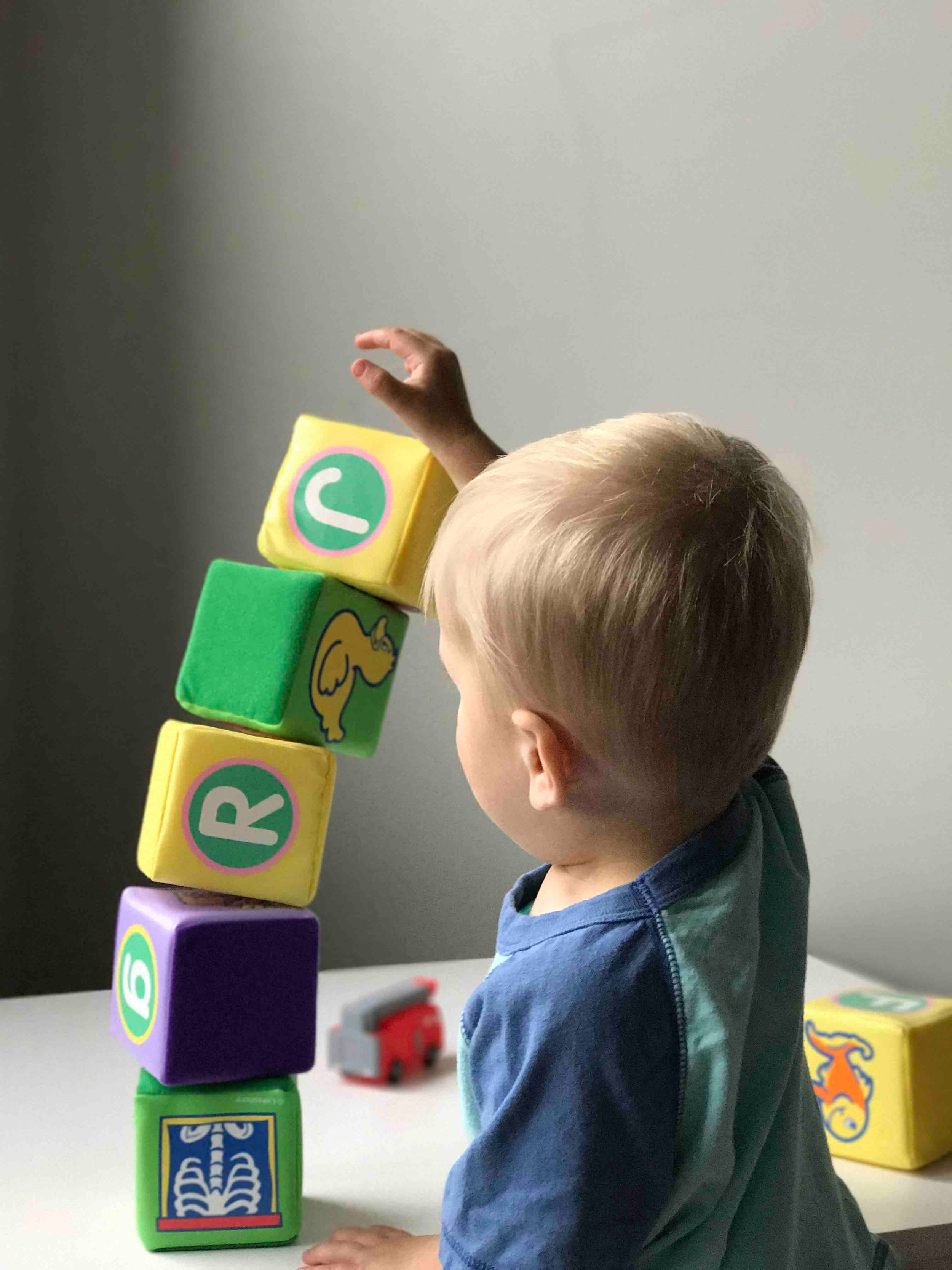 At 2 years old, most children are able to build towers of four or more blocks. This is one of many milestones your primary care provider will consider to determine how healthily your child is developing (  Ryan Fields   /   Unsplash  )