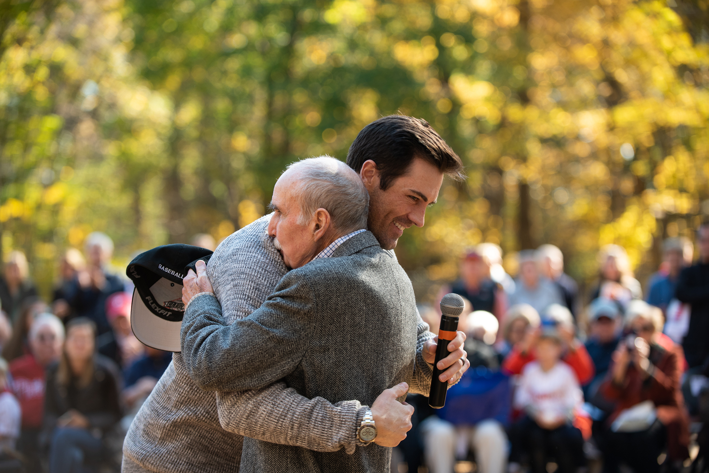 Former Philadelphia Phillies pitcher Cole Hamels hugs David P. Montgomery, Chairman of the Philadelphia Phillies at a dedication event honoring Montgomery on Sunday, November 4, 2018. Daisy Field in Roxborough was renamed in honor of Montgomery, who started with the Phillies in 1971 as a season-ticket salesman. He worked his way up to becoming marketing director, sales director and eventually the club president. Brianna Spause / Philadelphia Parks & Recreation