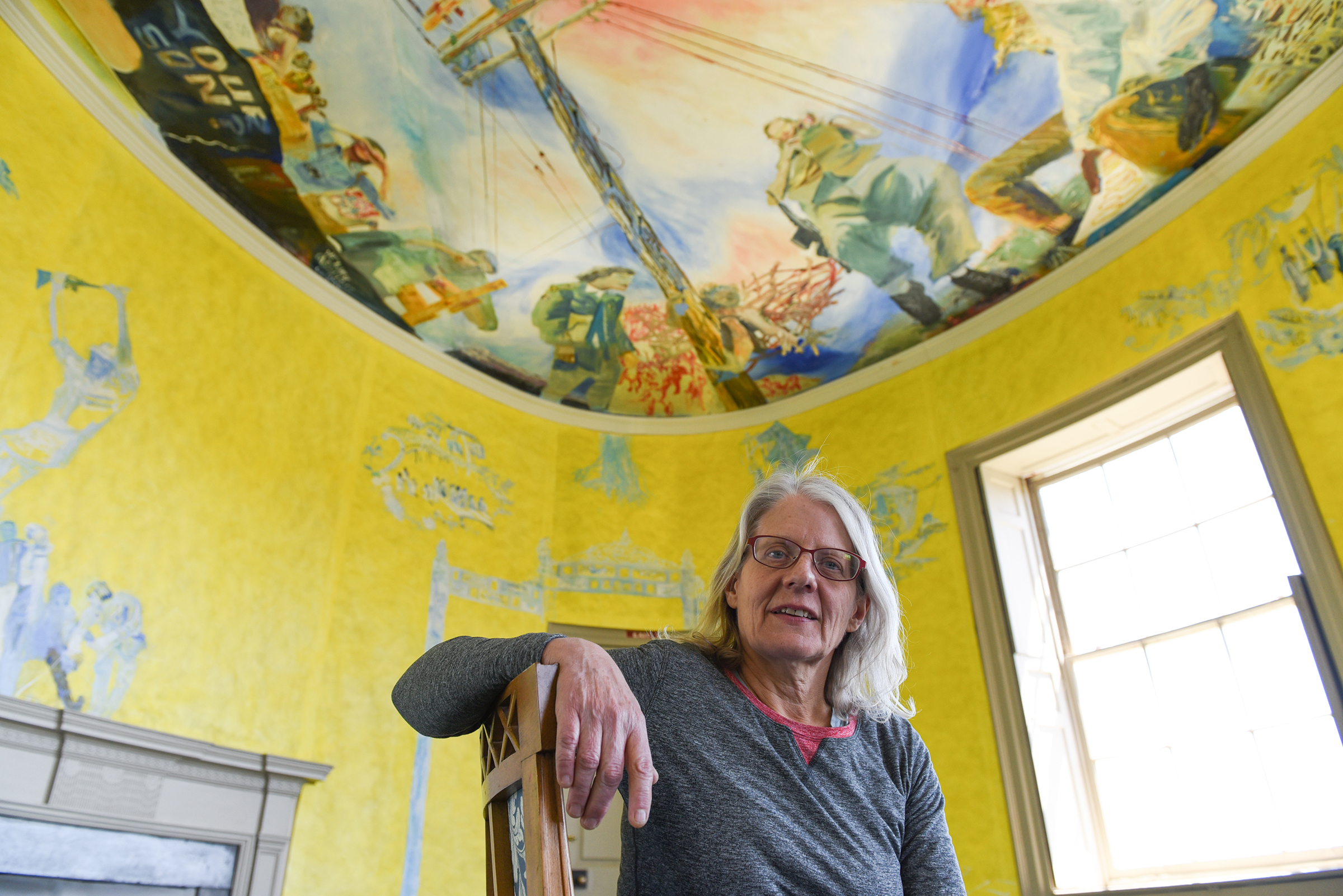 "Jane Irish poses for a portrait in her temporary installation, ""Antipodes"" at Lemon Hill Mansion in Fairmount Park on April 20, 2018. Irish transformed the 19th century mansion with floor-to-ceiling installations of paintings and ceramics that explored colonialism and anti-Vietnam War activism in Philadelphia. Brianna Spause / Philadelphia Parks & Recreation"