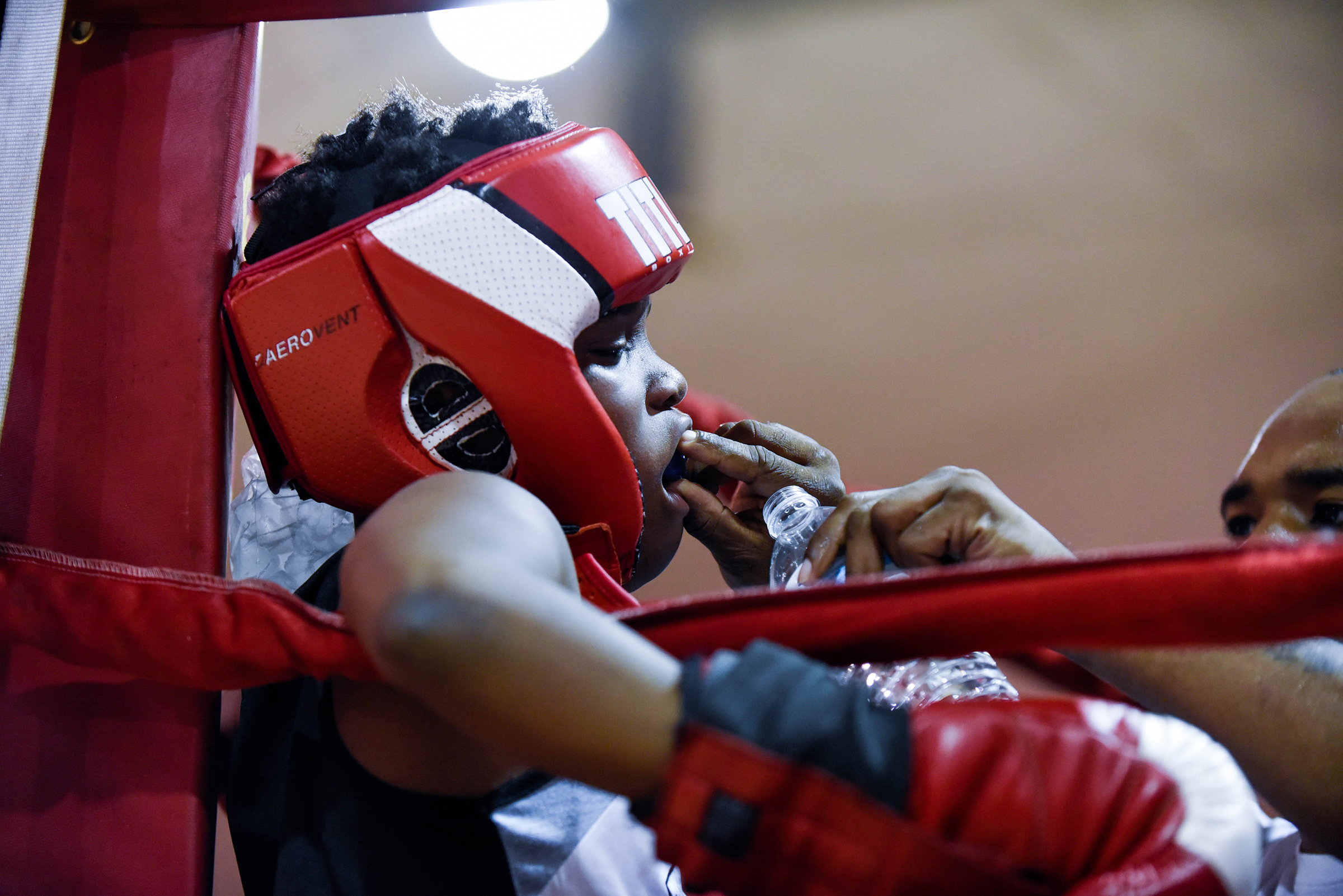A young boxer from Athletic Recreation Center rests between rounds at the Lucien Blackwell Boxing Showcase took place at Gustine Recreation Center on Friday, Oct. 5, 2018. Brianna Spause / Philadelphia Parks & Recreation