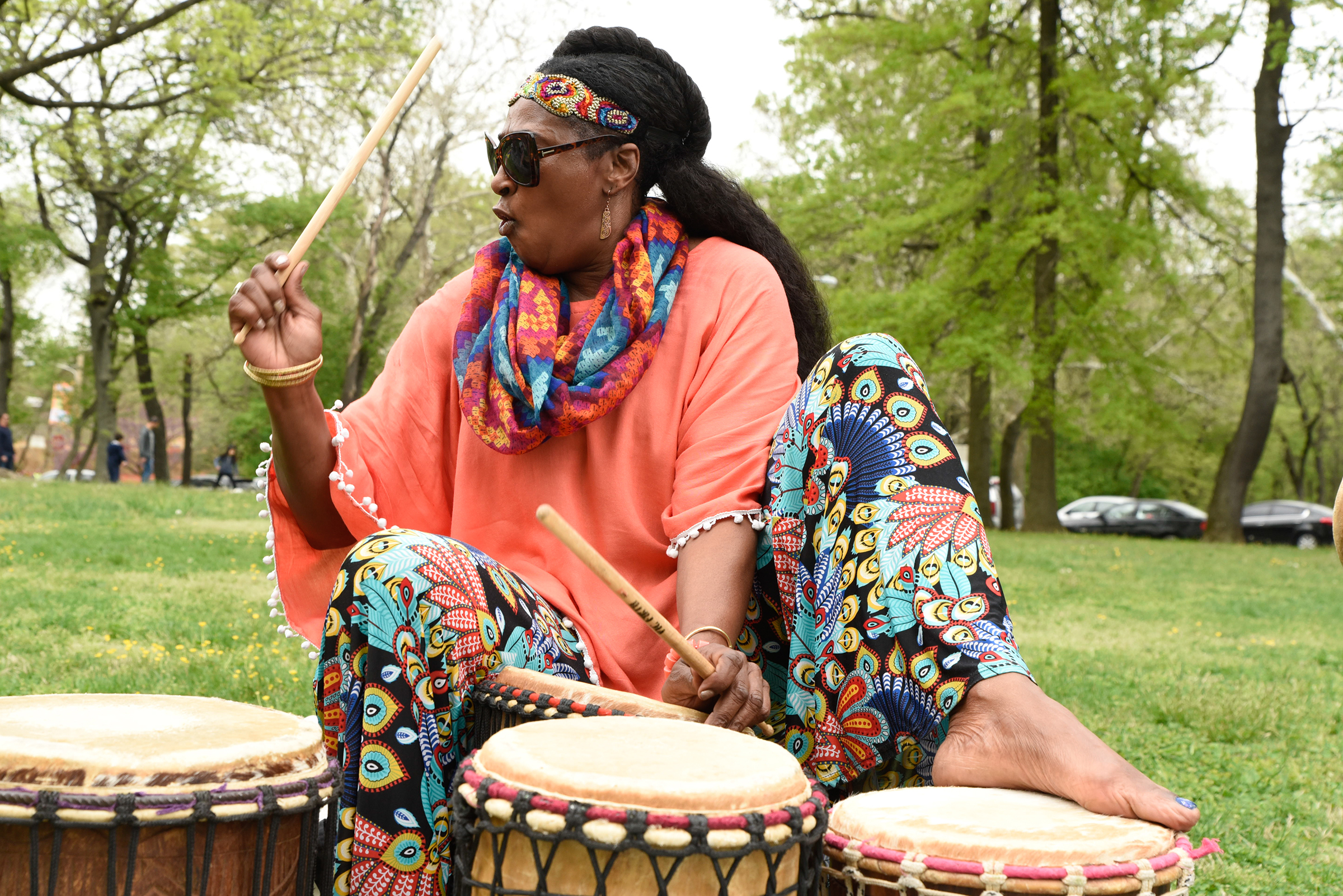 Mafalda Thomas-Bouzy plays the drums at the World Laughter Day celebration on the lawn of Smith Memorial Playground & Playhouse on May 6, 2018. Brianna Spause / Philadelphia Parks & Recreation