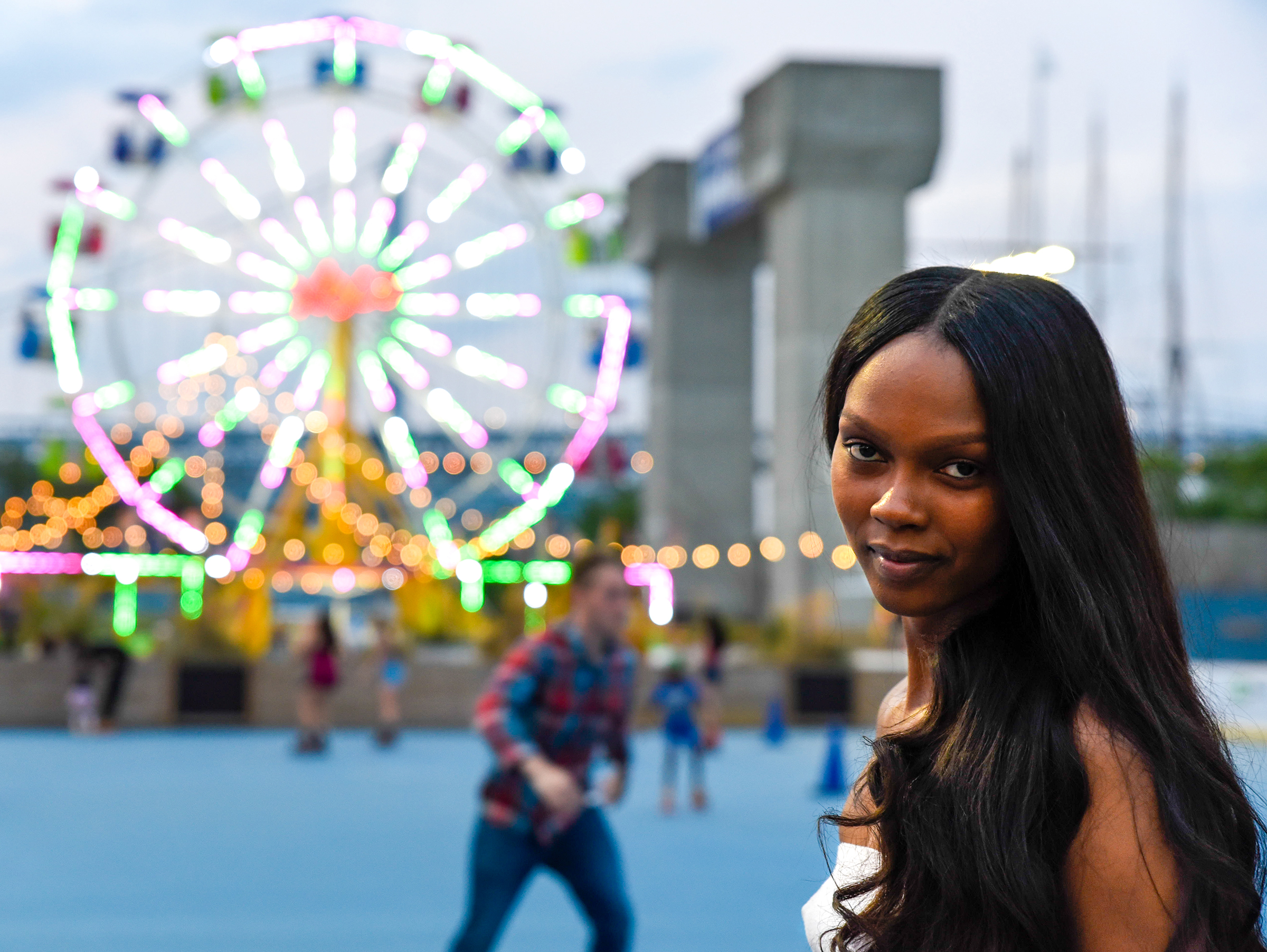 A woman pauses on the Summerfest roller skating rink at Penns Landing on July 11, 2018. / Brianna Spause.