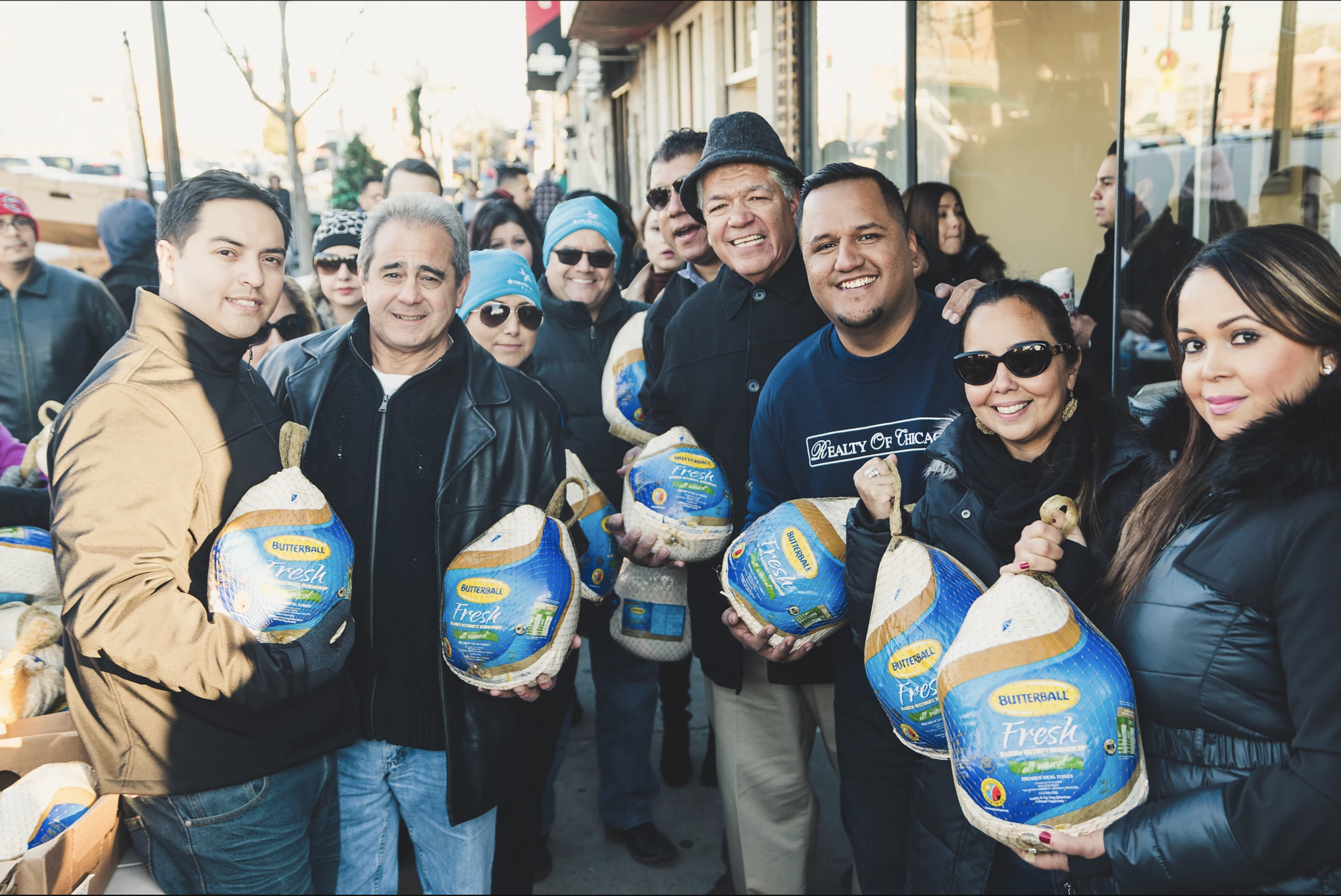Realty of Chicago'sTurkey Giveaway - One of the best traditional events Realty of Chicago started is their annual turkey giveaway. It was started in 2014 by giving away 500 turkeys within the community a few days before thanksgiving. This quickly became an amazing tradition when their agents challenged themselves to give away double of what they did the previous year. In 2015 they fed more than 5,000 people on thanksgiving.