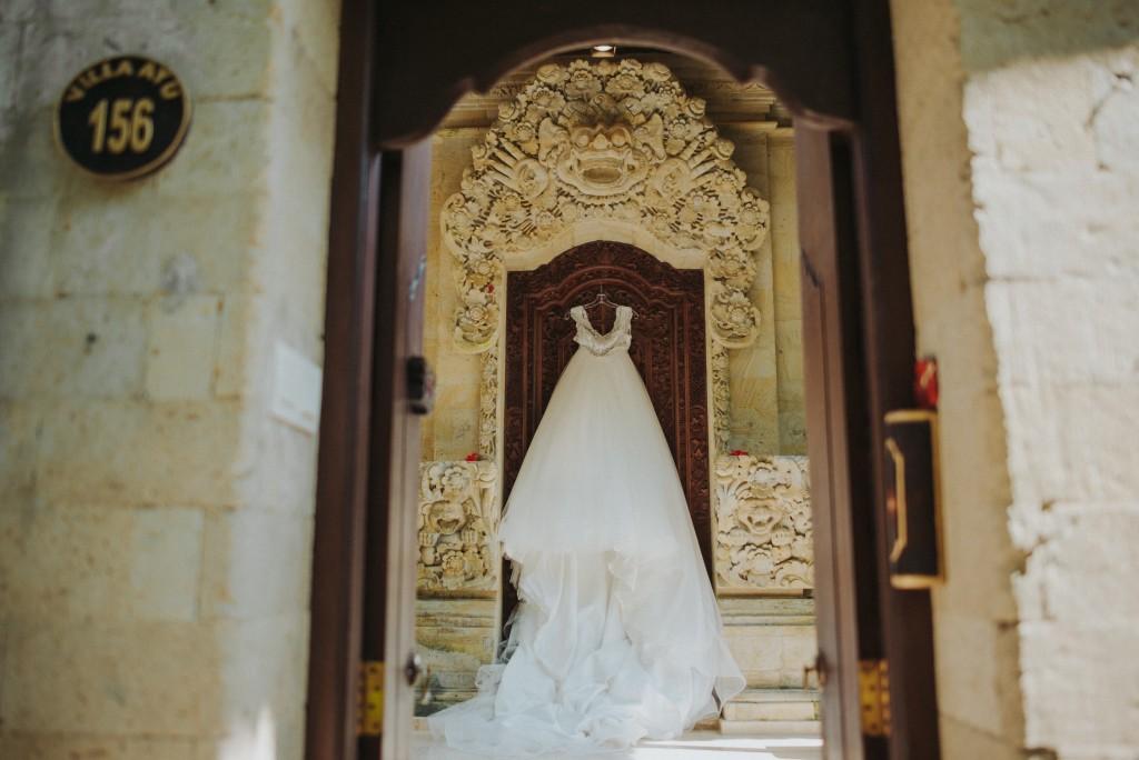 A wedding dress hanging in a doorway.jpg