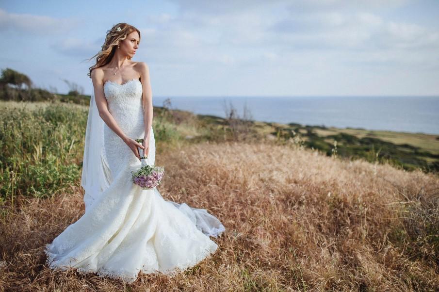 Bride in the wild grasses of the Whitsundays.jpg