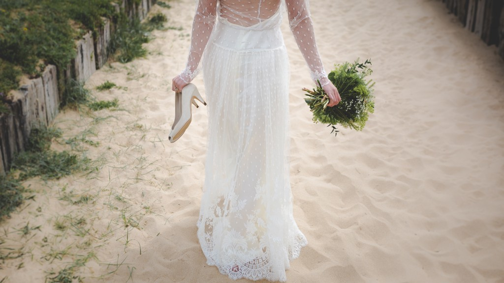A bride walking down the beach after marrying in Bali.jpg