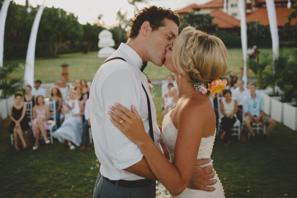 A bride and groom kissing.jpg