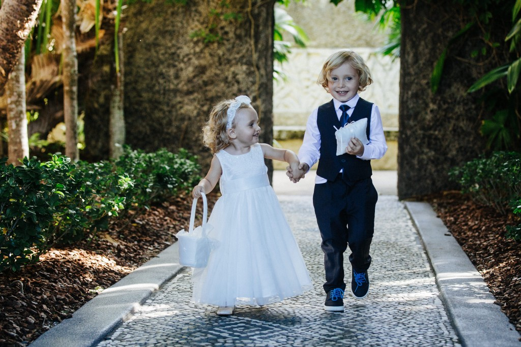 A flower girl and ring boy walk up the aisle.jpg