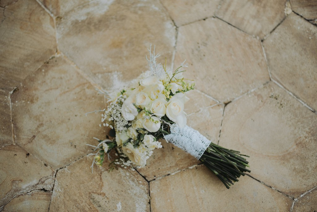 A white and green bali wedding bouquet.jpg