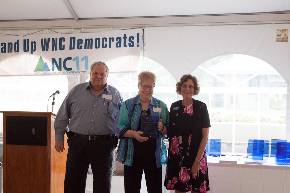 Jackson County Chair, Frank Burrell presenting the Liston B. Ramsey Award to Lorna Barnett