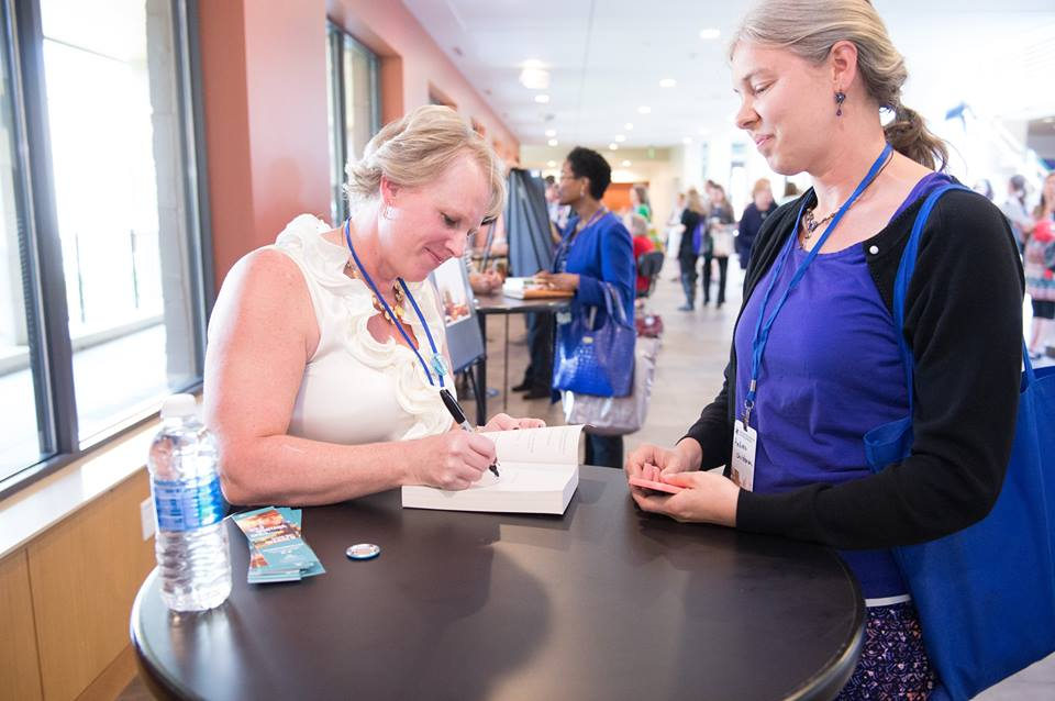 """#tbt to the time I met Susan May Warren!! She is signing my copy of """" Take a Chance on Me """" another great, must read book. I'll loan you my copy, but please don't drop it in the bath!"""