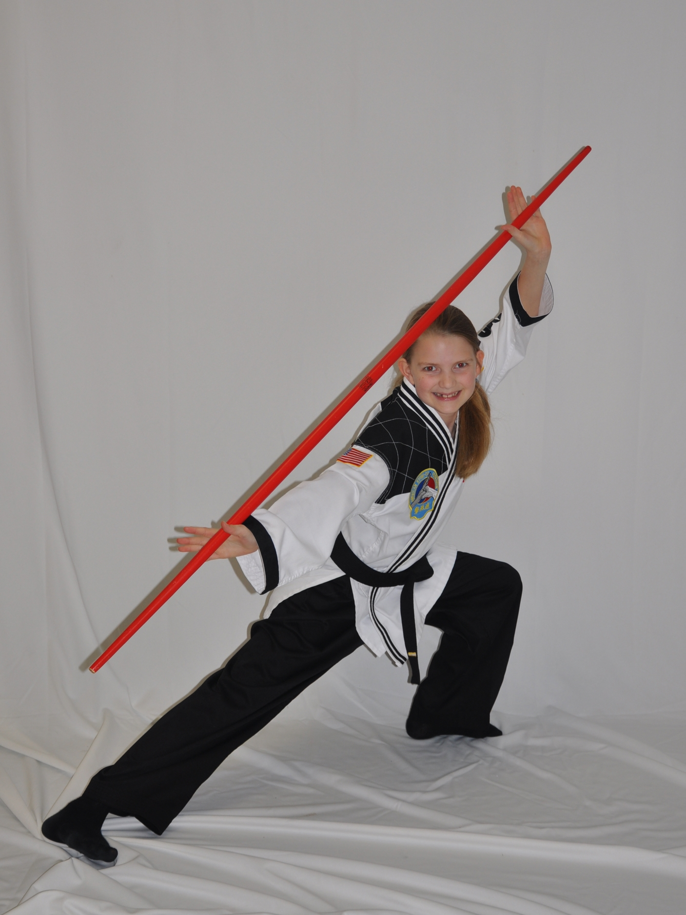 My daughter, a fearless leader, demonstrating a classical Bo Staff stance shortly after receiving her black belt.