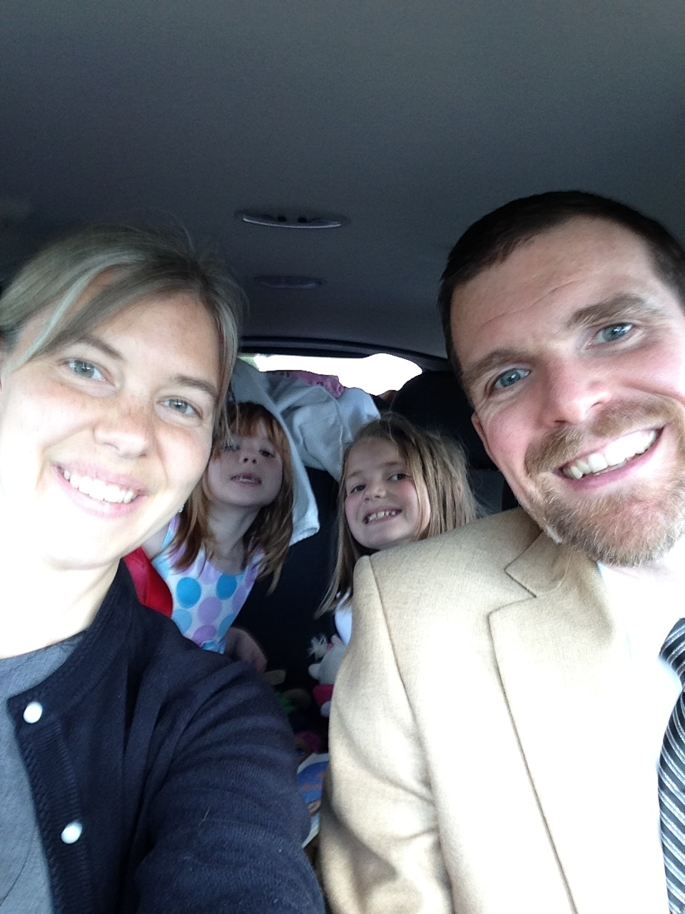 An old photo of us as we prepare for an epic road trip. Note the luggage piled in the back. Also, no, we don't dress up for road trips, we just happened to be heading out straight after church.