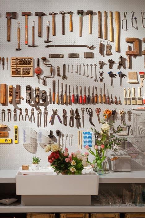 Tools displayed on a peg wall.