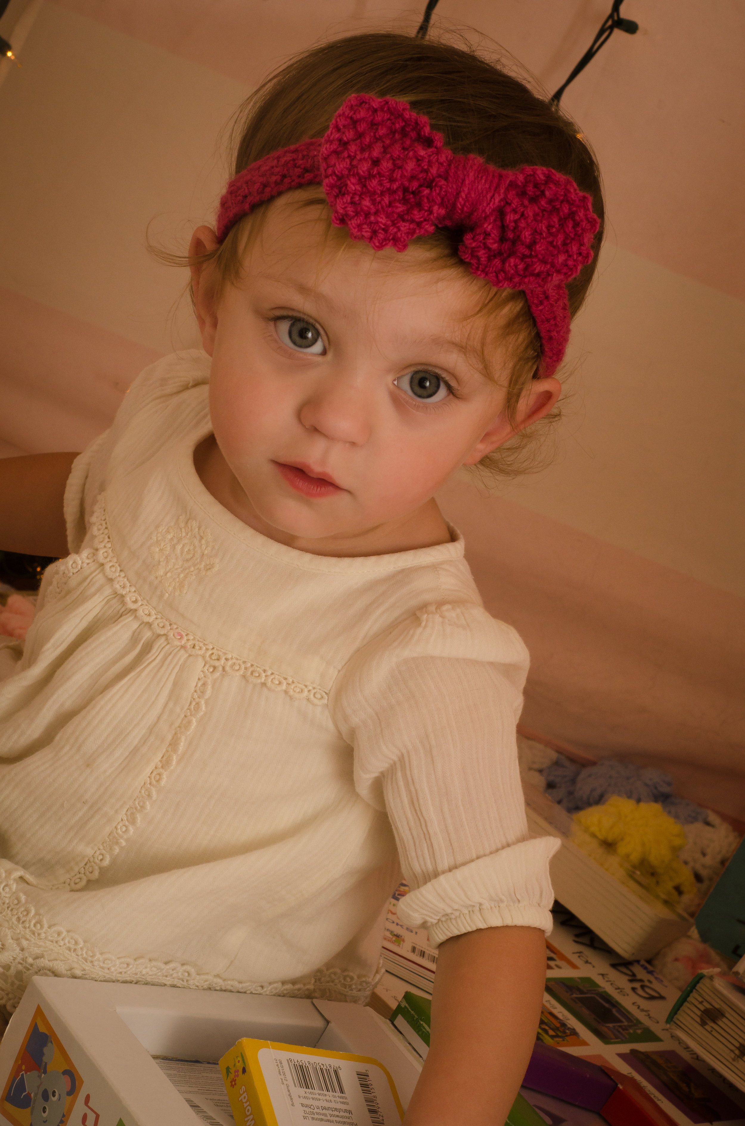 Adeline's wearing a bow from  NICU Knits  which is made by a NICU nurse. She also donates 10% to Bliss Charity for Preemies.