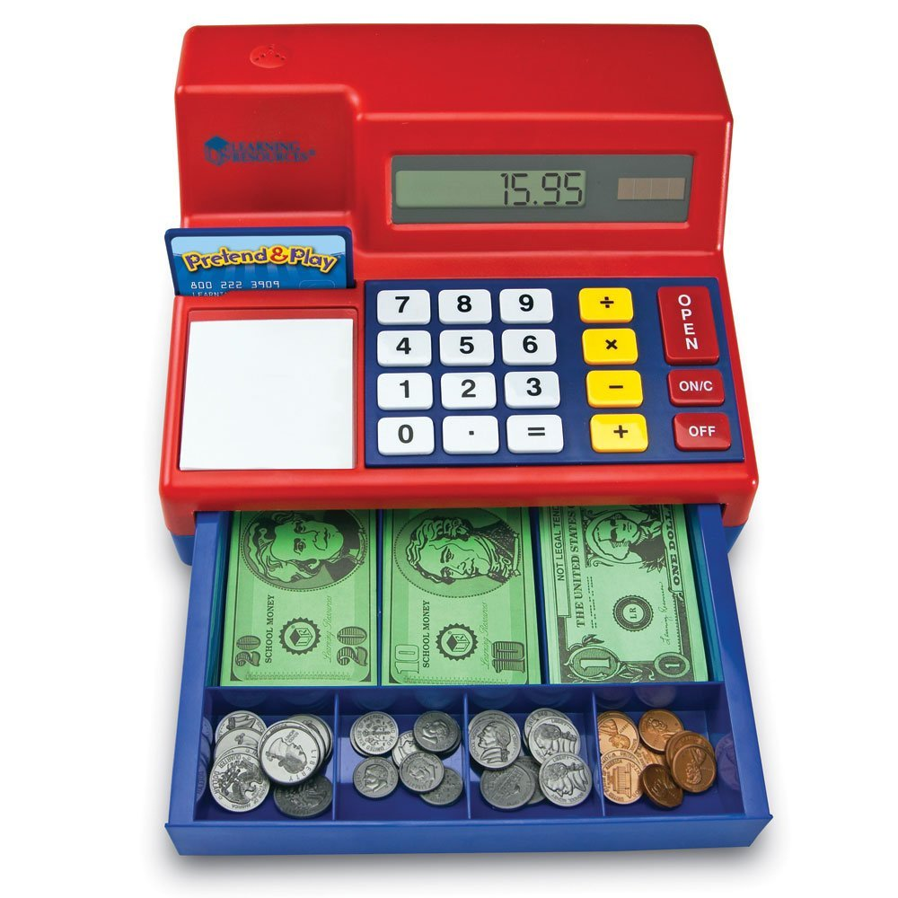 """play store - Dramatic play opens the door for so many language opportunities and kids will love playing store for years. It is good to teach social skills, turn taking, pretend play, etc. but you can also use the cash register to work on requesting the coins/money and such vocabulary such as; please/more/thankyou/in/open/out/ help/click/stuck/uh-oh/where? I'll also block the opening, and work on """"move"""" or """"move please,"""" if they want to put the money in the hole. The kids love it. You can also use a shopping cart or play food/basket to expand on your play."""