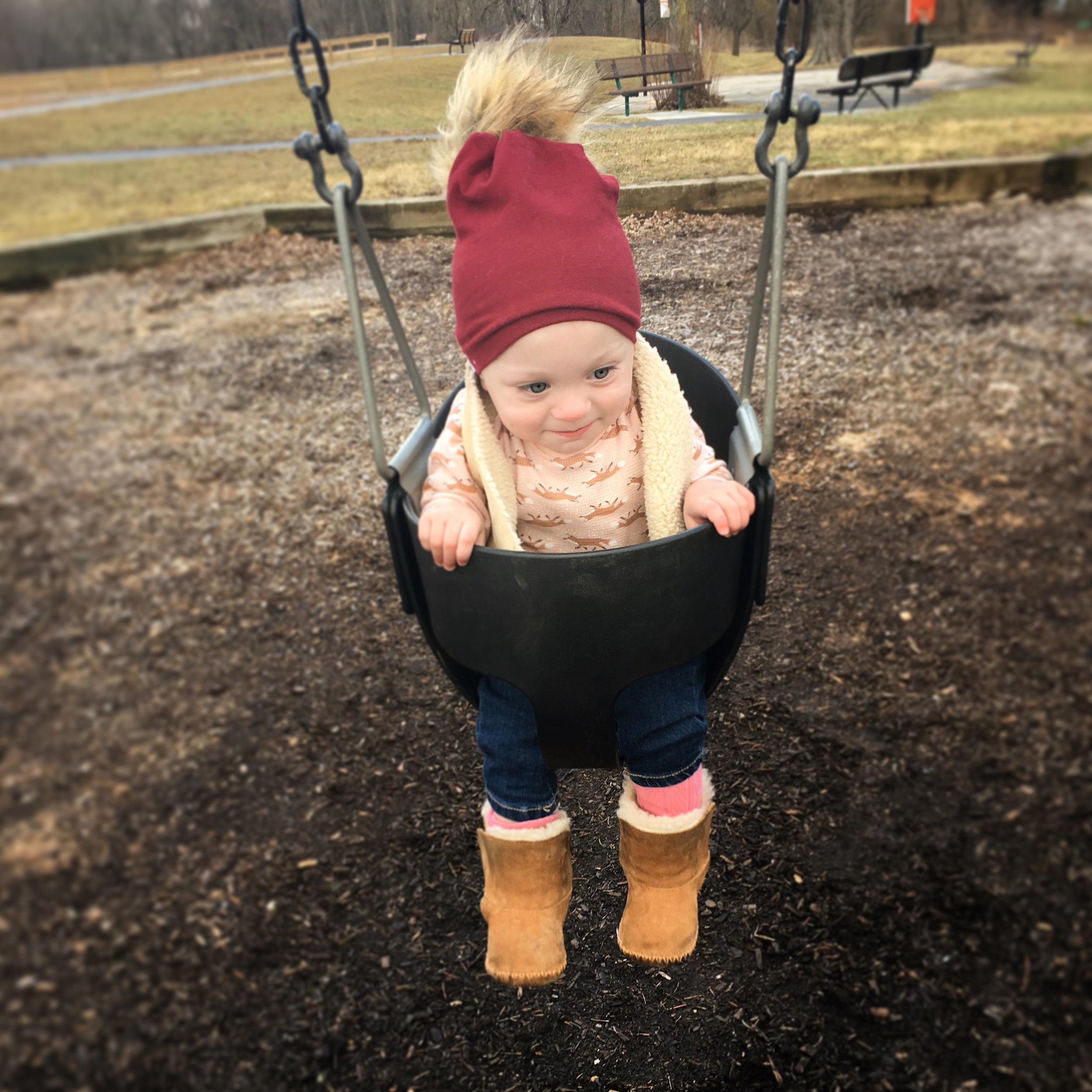 """Swinging gets her moving, outdoors, and is perfect to practice verbal routines such as """"ready, set, GO!"""""""
