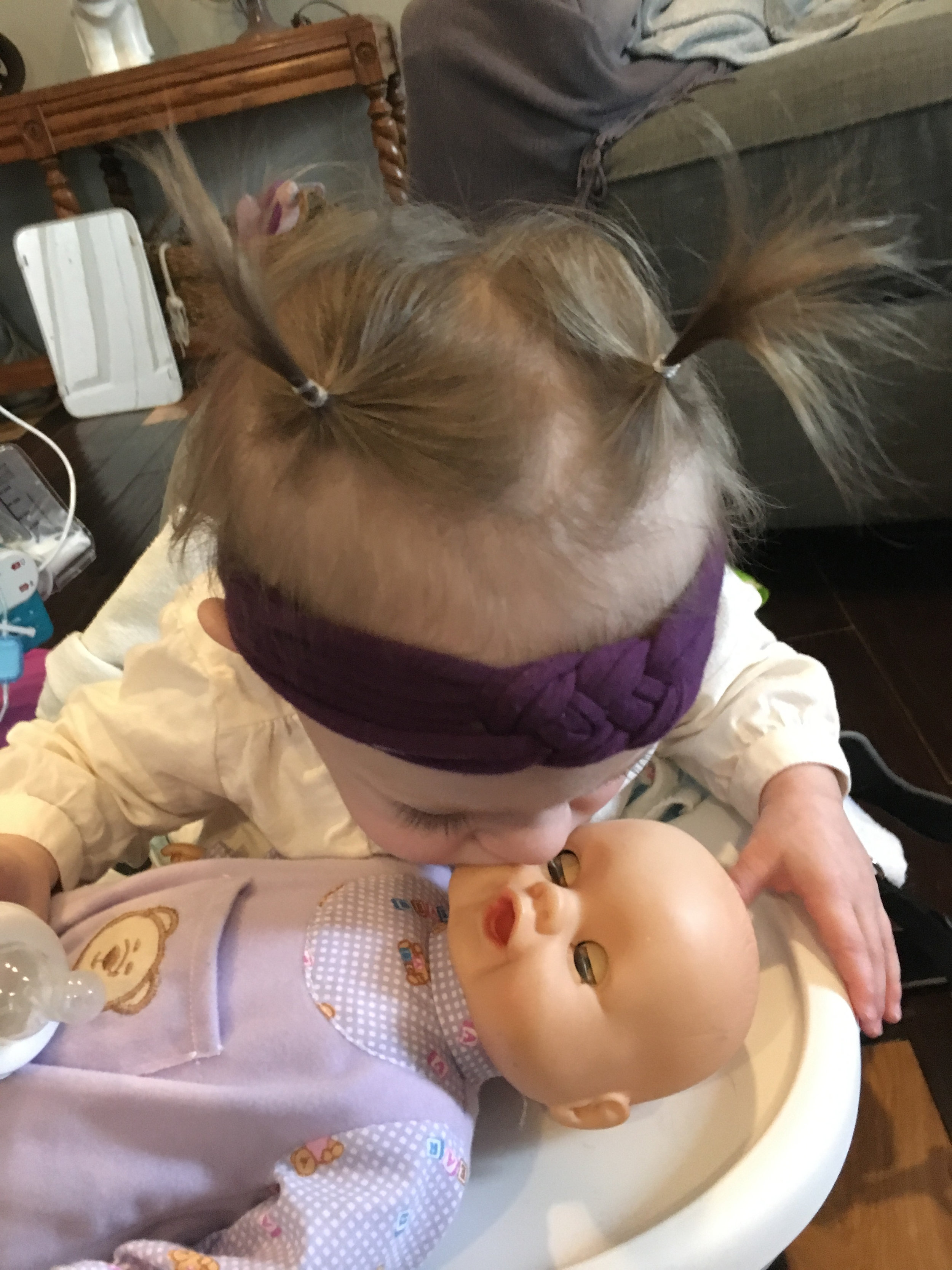 """Baby Dolls - Every child should have a baby doll and that includes boys and for the purpose developing language I would not recommend a doll that talks, eats, needs batteries, etc. I love a doll for so many skills; language, cognitive, fine motor, and self-help skills. Dolls can be used to teach body parts, receptively or expressively. It also shows them their nose does not just apply to their own nose. Use the doll to teach basic concepts such as prepositions; baby in the bed, baby under the blanket. Use the doll to teach verbs or feelings; eat, drink, sleep, sit, stand, hungry, sleepy, thirsty, and more. You can ask your child questions to work on his understanding of these words while he plays. """"Where is baby?"""""""